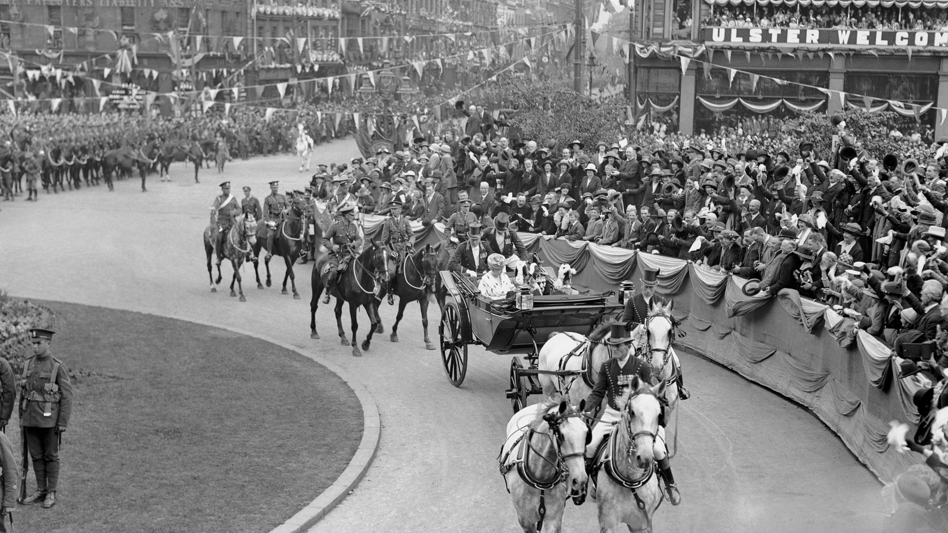 NI'S LONG AND WINDING ROAD: King George V and Queen Mary arrive for the opening of the parliament of Northern Ireland in Belfast, on June 23 1921 - Credit: Mirrorpix via Getty Images