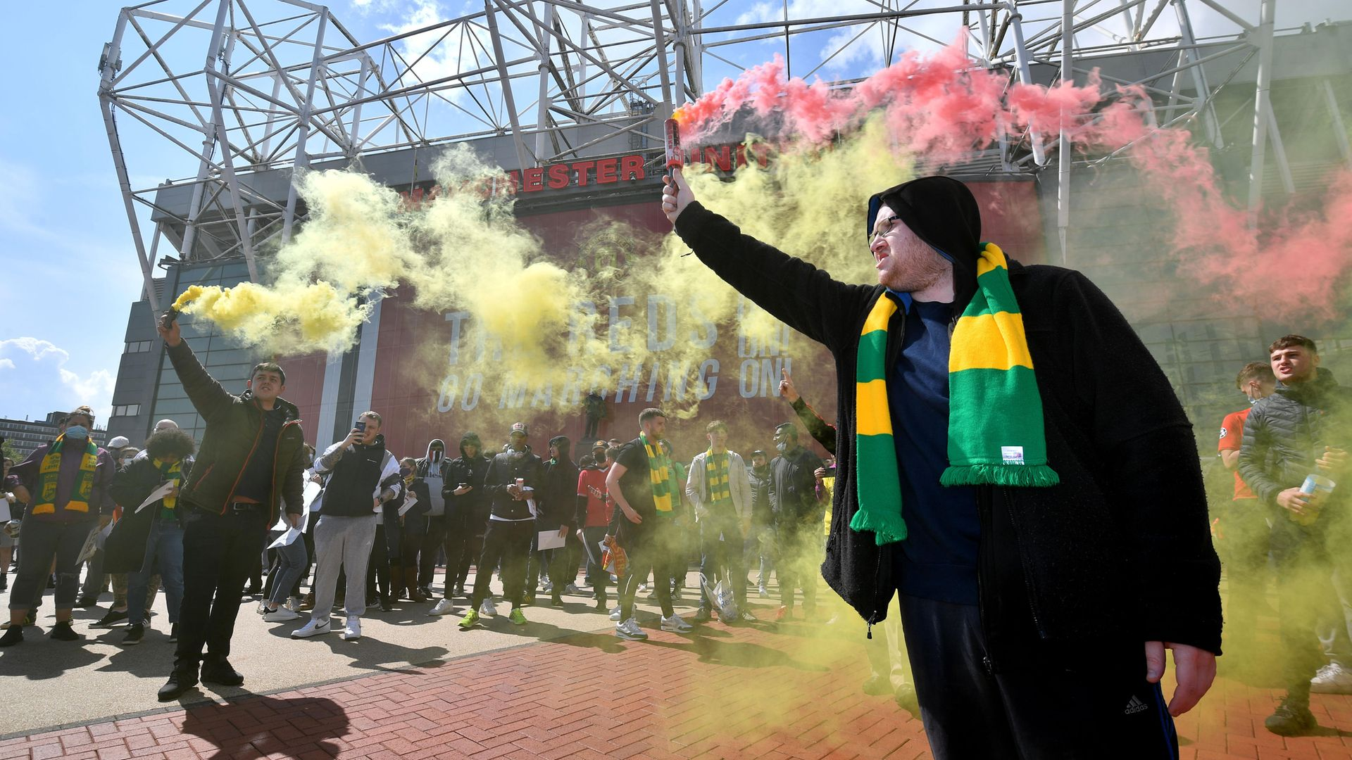 Manchester United fans protest but those who believe the German 50+1 system will bring equality (right) are misguided - Credit: Offside via Getty Images