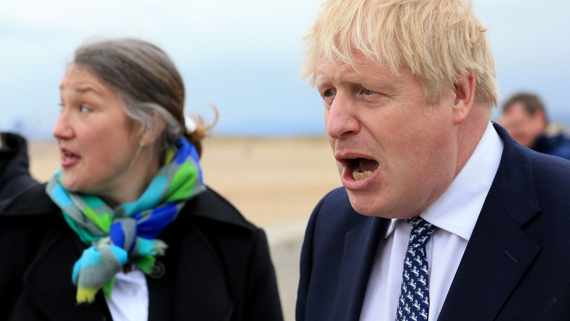 Prime minister Boris Johnson (right) reacts as he campaigns on behalf of Conservative Party candidate Jill Mortimer in Hartlepool, in the north-east of England ahead of the 2021 Hartlepool by-election to be held on May 6 - Credit: PA