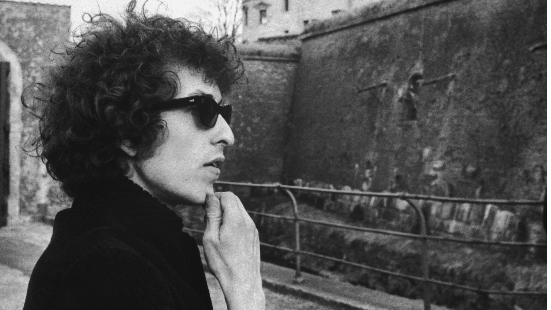 Bob Dylan contemplates Kronborg Castle, the Elsinore Castle of Shakespeare's Hamlet, shortly after arriving in Denmark to start his 1966 world tour. - Credit: Bettmann Archive/Getty Images