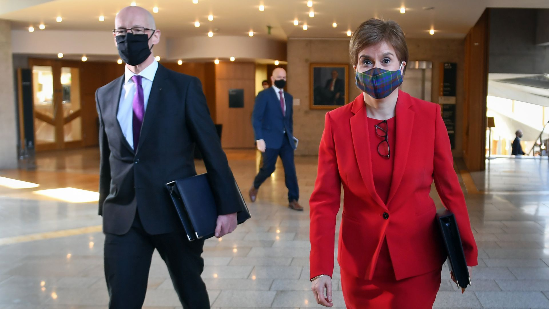 Scotland's deputy first minister, John Swinney, (L) arriving for First Minister's Questions at the Scottish parliament in Holyrood with first minister Nicola Sturgeon. Swinney declared the SNP was on course to win a 'historic' fourth term in government - Credit: PA