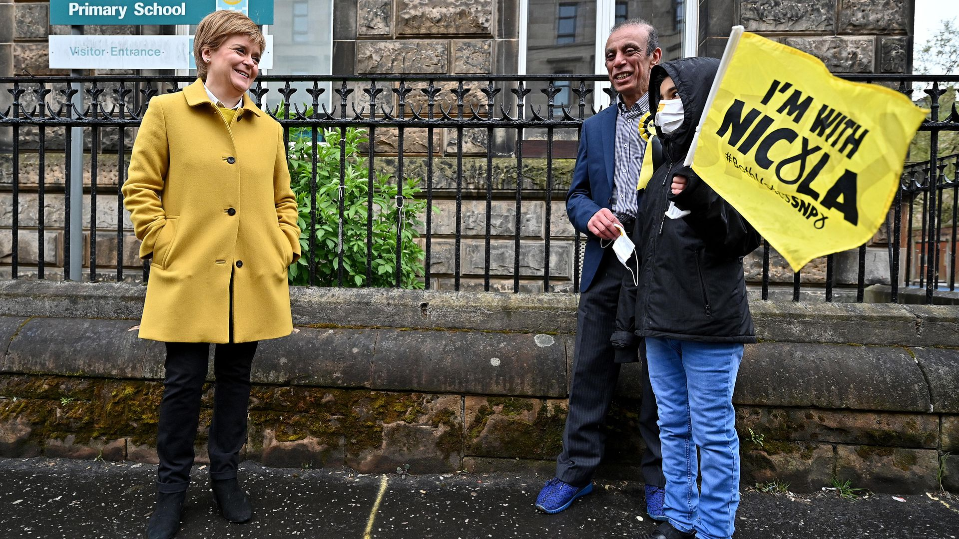 First Minister and leader of the SNP Nicola Sturgeon meets voters as she arrives to cast her vote in the Scottish Parliamentary election at the Annette Street school in Govanhill, Glasgow - Credit: PA