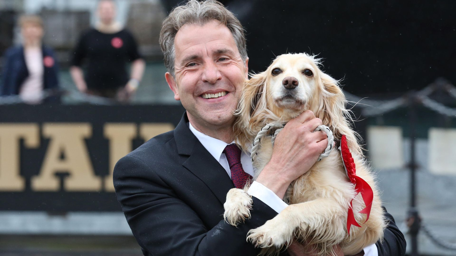 Labour's Dan Norris celebrating with his dog Angel after being elected West of England mayor - Credit: PA