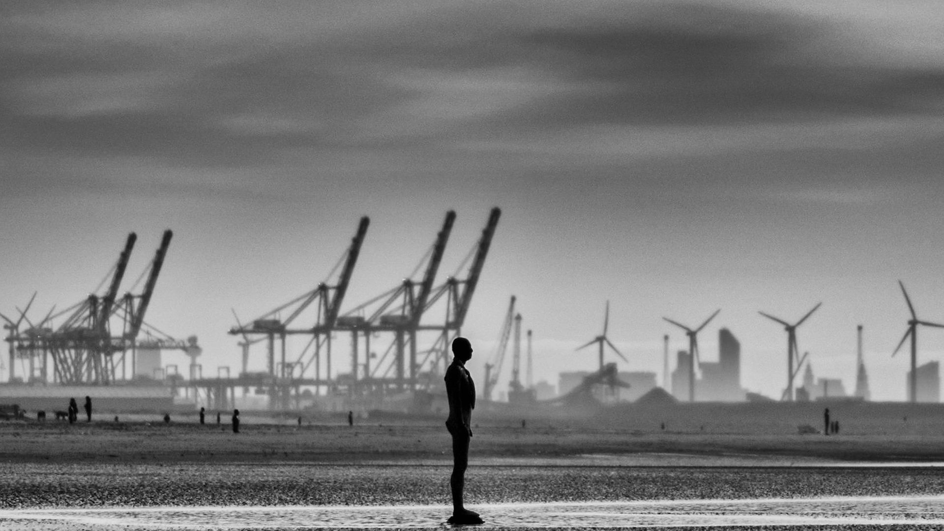 A statue of Antony Gormley's art installation Another Place at Crosby beach - Credit: Getty Images