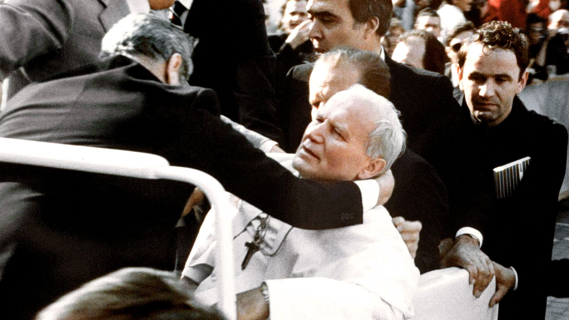 Bodyguards hold Pope John Paul II (C) after he was shot 13 May 1981 on Saint Peter's square by a Turkish extremist - Credit: AFP via Getty Images