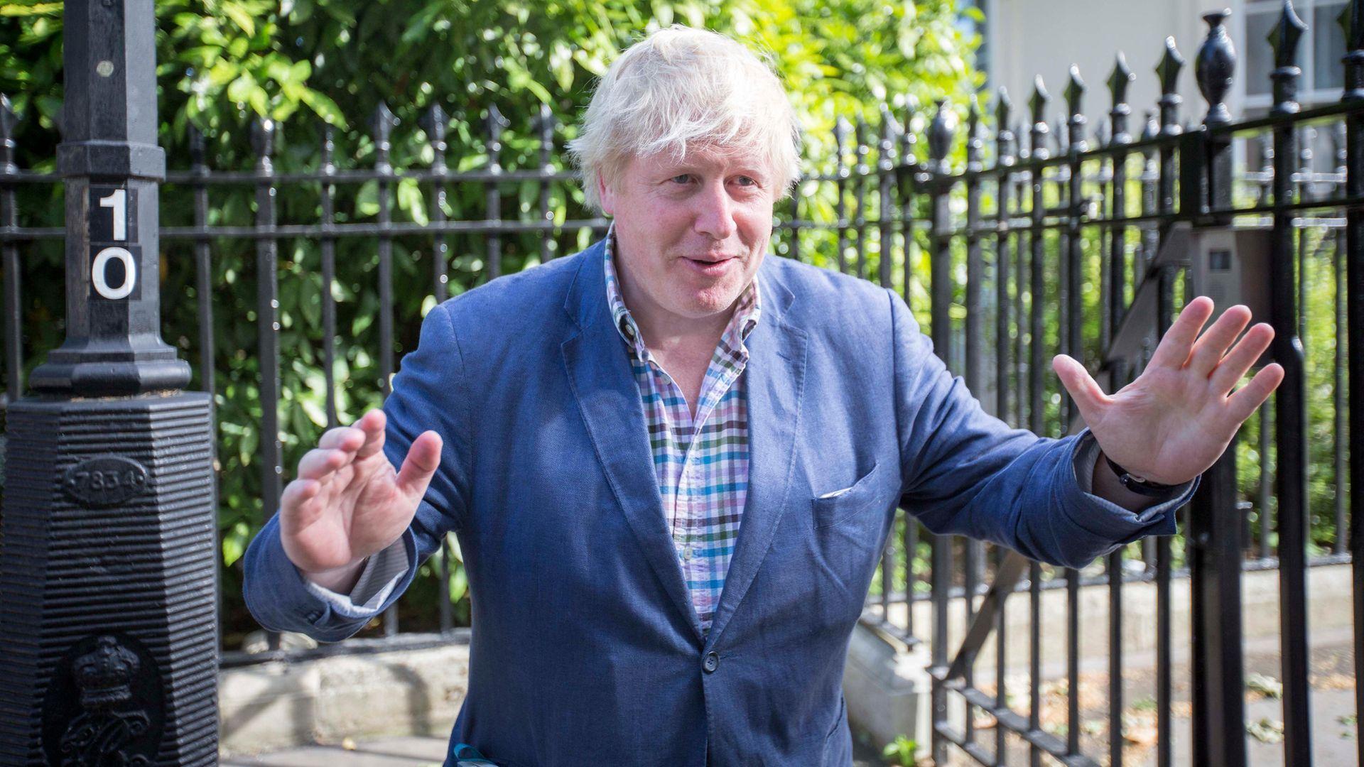 Boris Johnson speaks to the media - Credit: PA