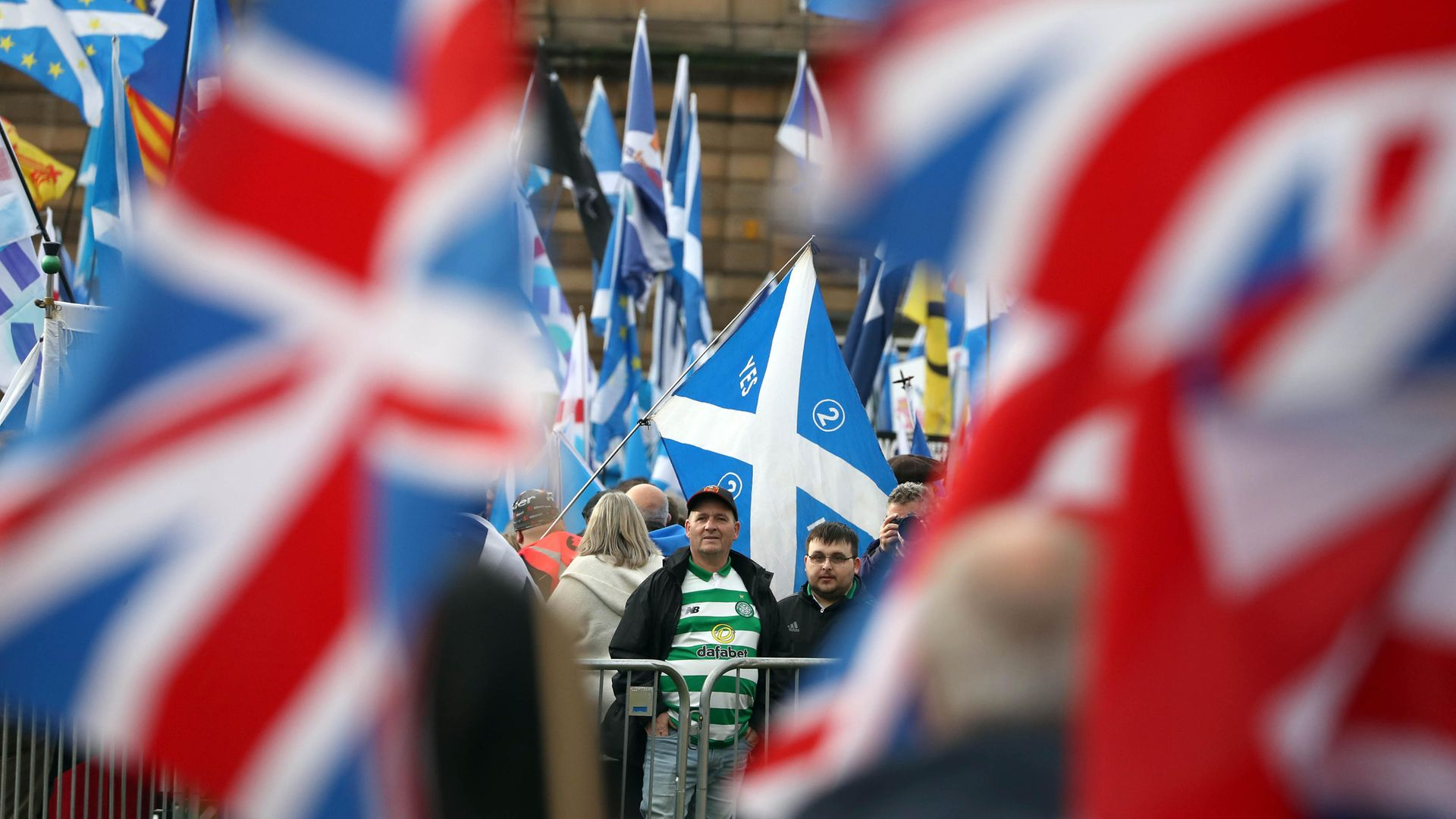 Independence and Union supporters in George Square in Glasgow - Credit: PA