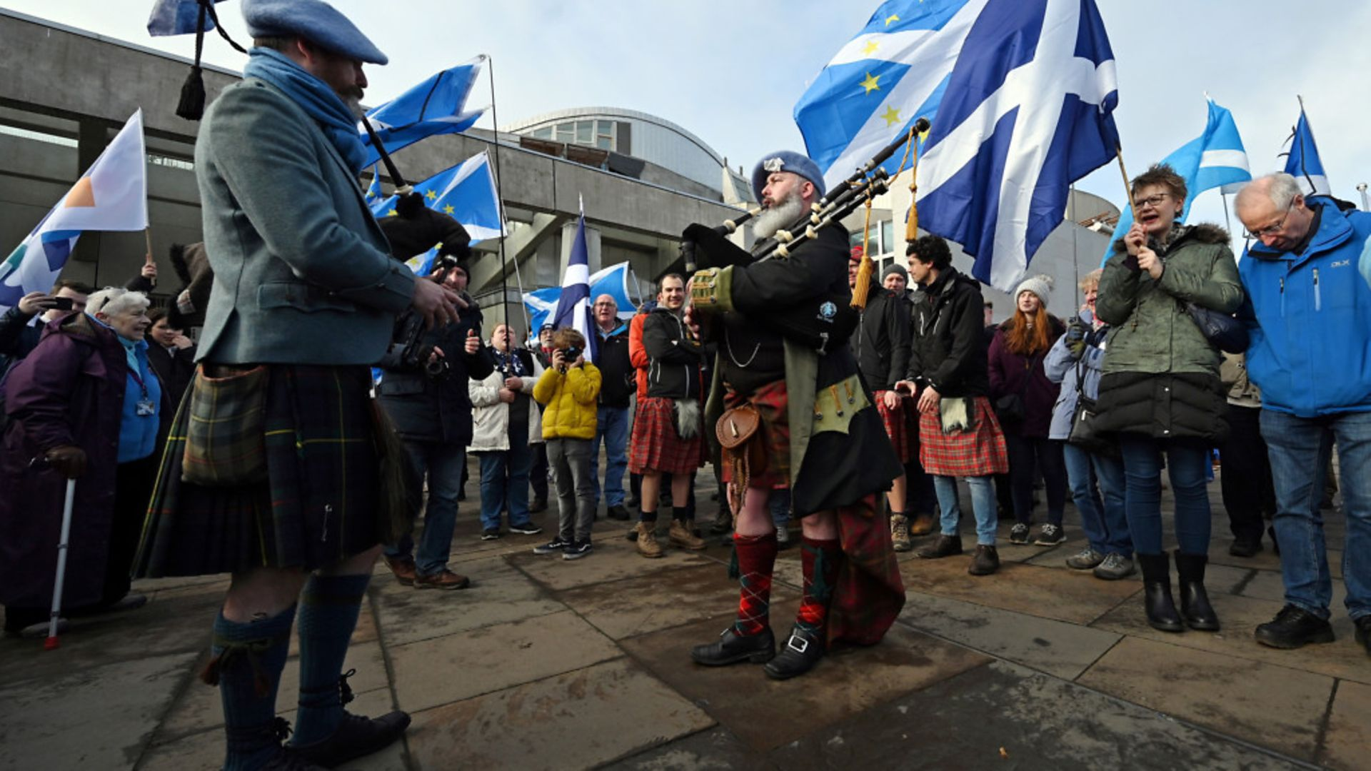 COMMON CAUSE? Saltire flags with EU stars on them are flown at a pro-Scottish independence, anti-Brexit demonstration outside Holyrood - Credit: Andy BUCHANAN / AFP