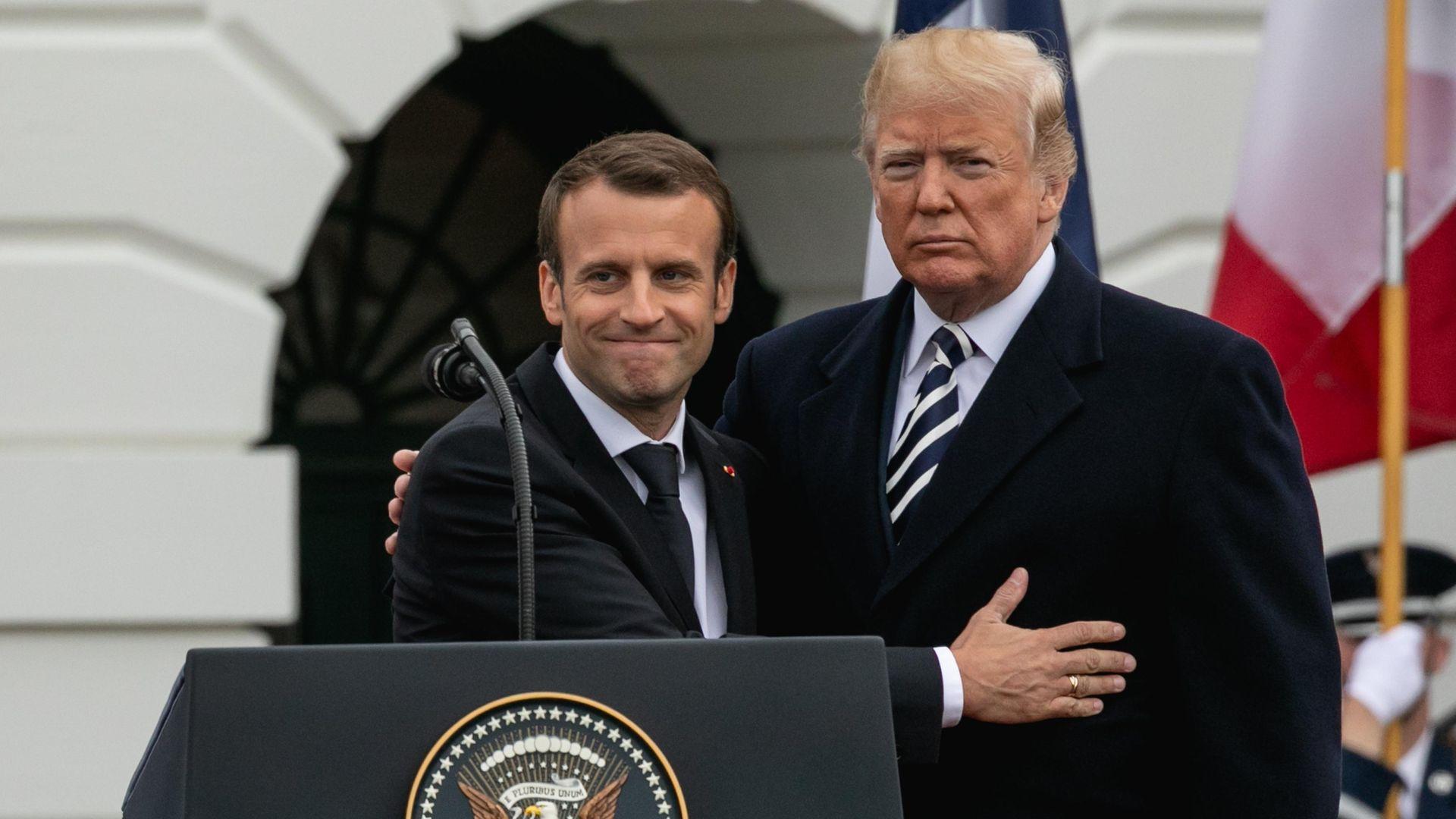 French President Emmanuel Macron and then US President Donald Trump hug - Credit: NurPhoto via Getty Images
