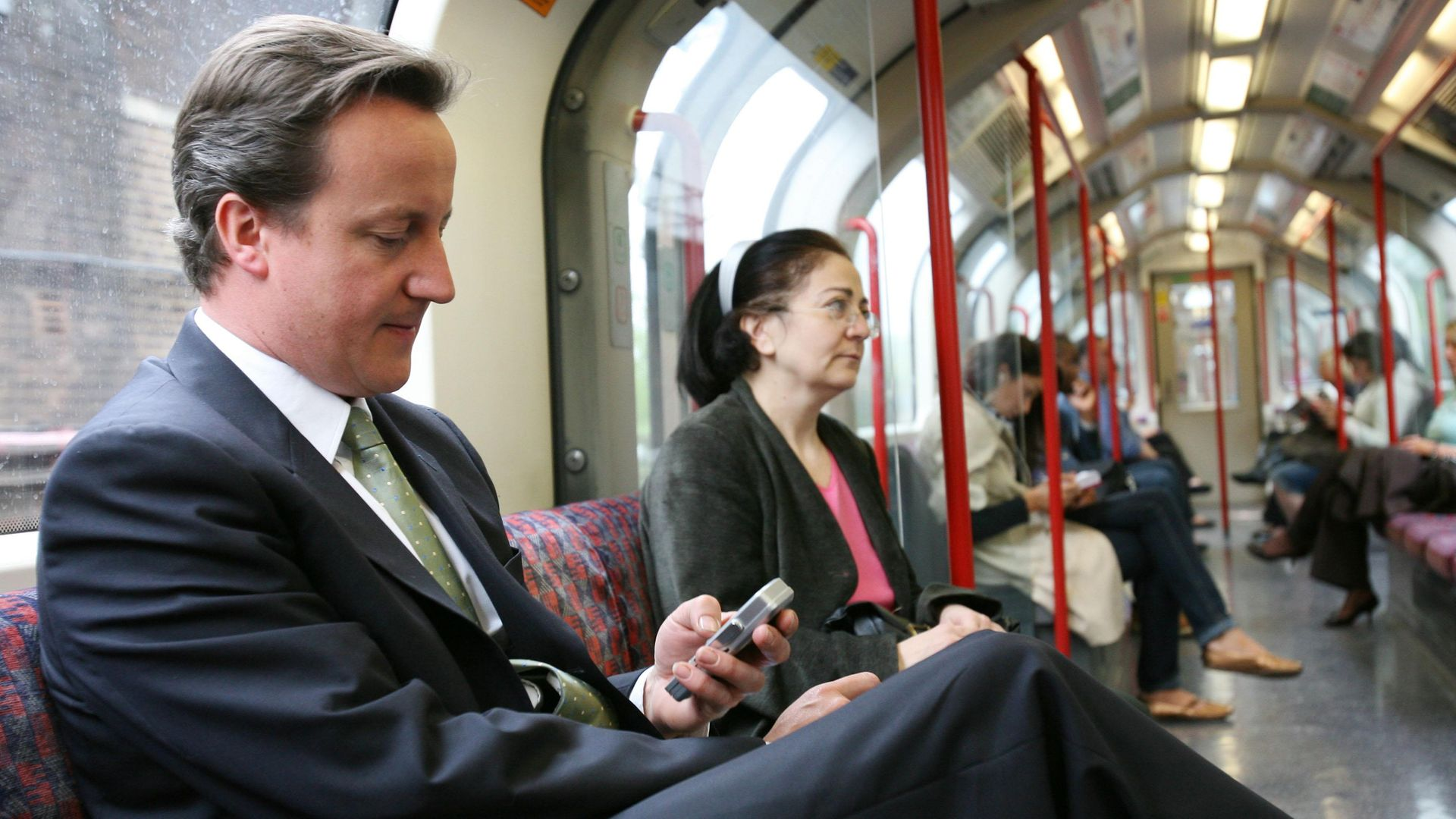 David Cameron on the tube back to central London from Epping - Credit: PA