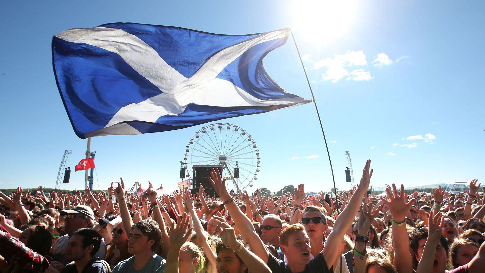 Music fans with a Saltire Flag in Kinross, Scotland - Credit: PA