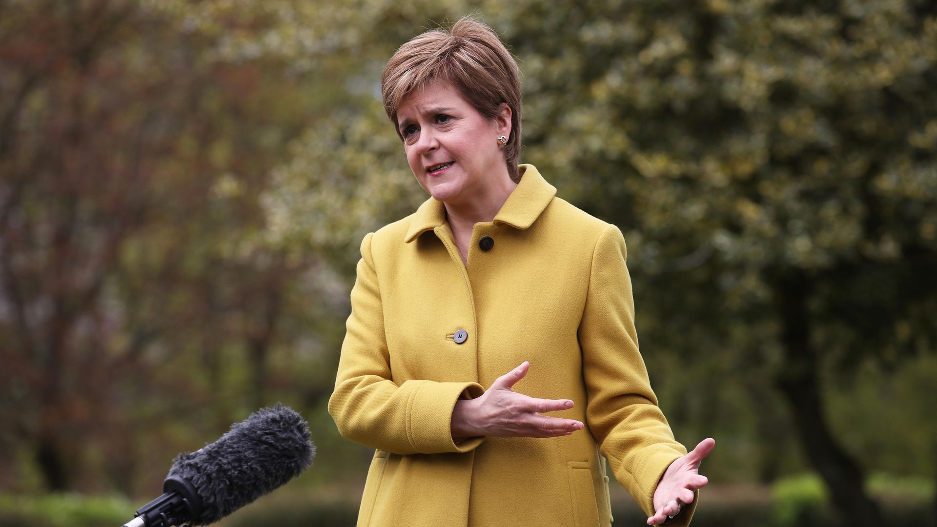 Scottish First Minister and SNP leader Nicola Sturgeon speaks to the media during a visit to Airdrie, North Lanarkshire - Credit: PA