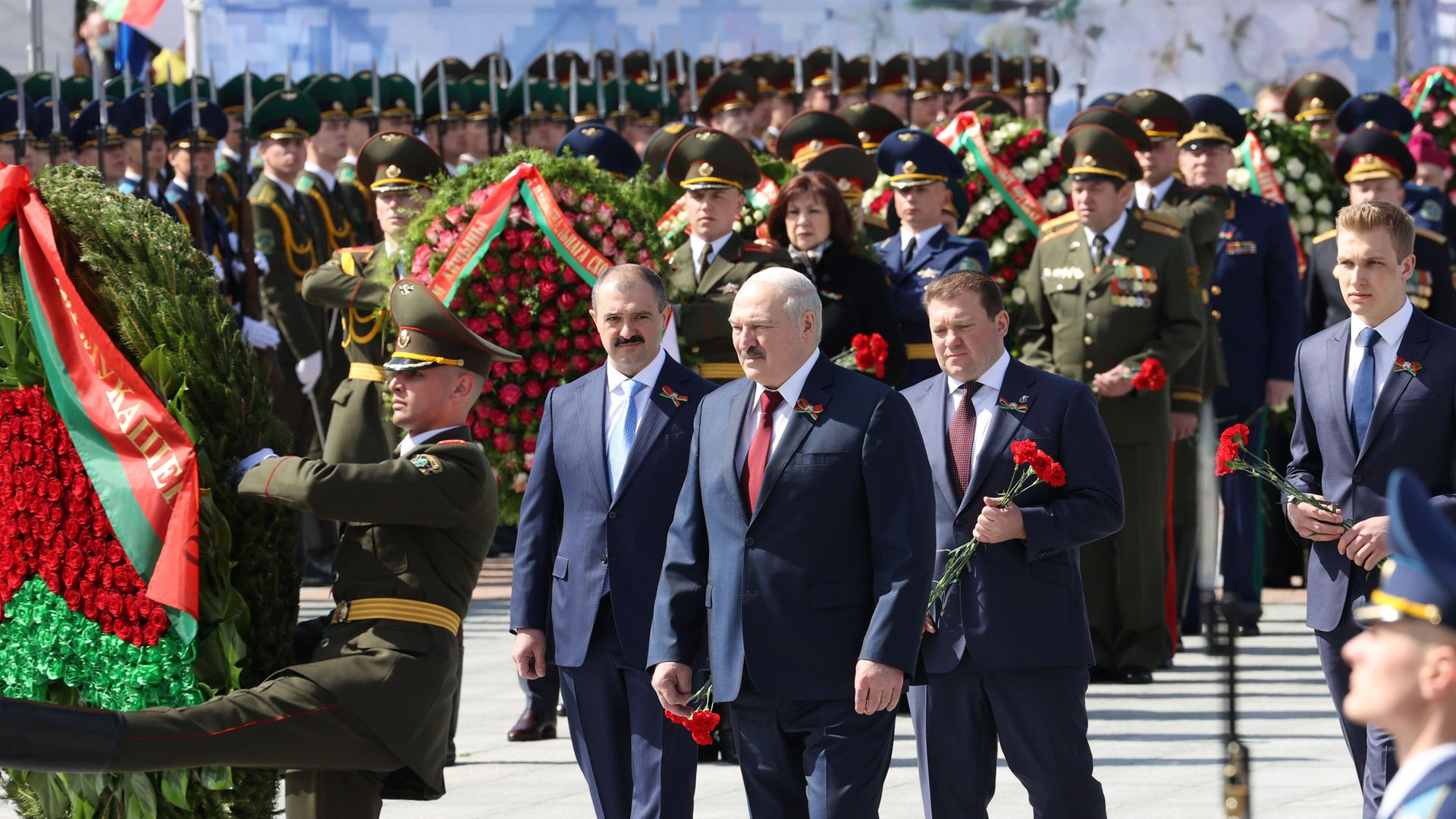Belarus' president Alexander Lukashenko (C front), with his sons, presidential security aide Viktor Lukashenko, Belarusian National Olympic Committee member Dmitry Lukashenko, and his youngest son Nikolai Lukashenko (L-R), as they lay wreaths on Victory Day, 2021 - Credit: Maxim Guchek/BelTA/TASS