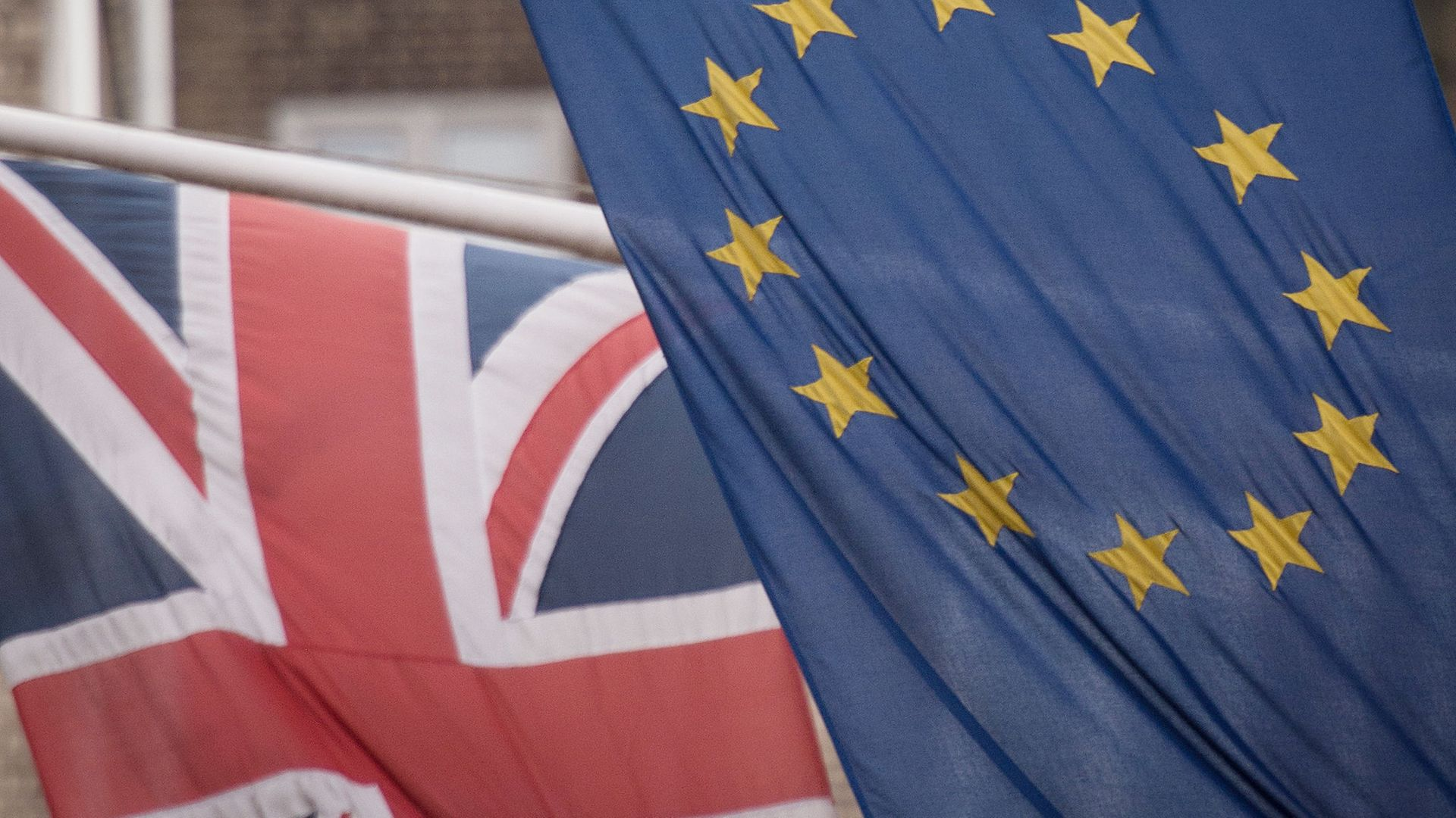Picture of the EU and Union flags. The Centre for European Reform (CER) estimates that leaving the single market and customs union at the end of 2020 has reduced UK trade by £7.7billion, or 11%, since March - Credit: PA