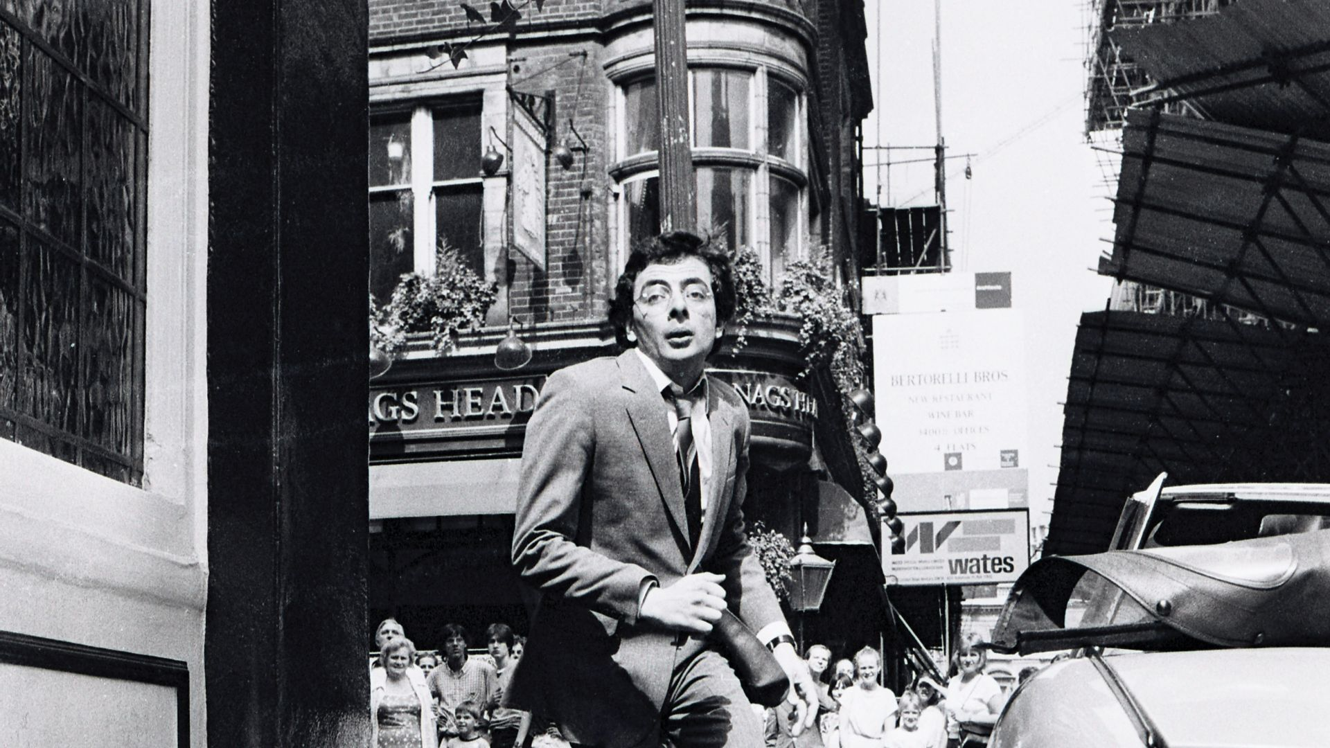 Rowan Atkinson, shooting the 1983 film Dead on Time, in central London: outside the White Lion, Covent Garden - Credit: Getty Images