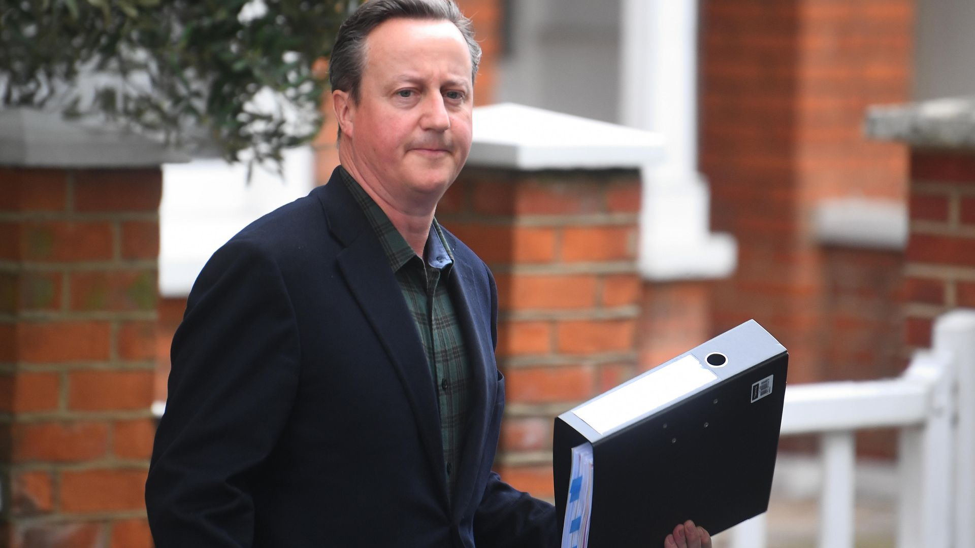 David Cameron leaves his home in London ahead of giving evidence to the Commons Treasury Committee on Greensill Capital - Credit: PA