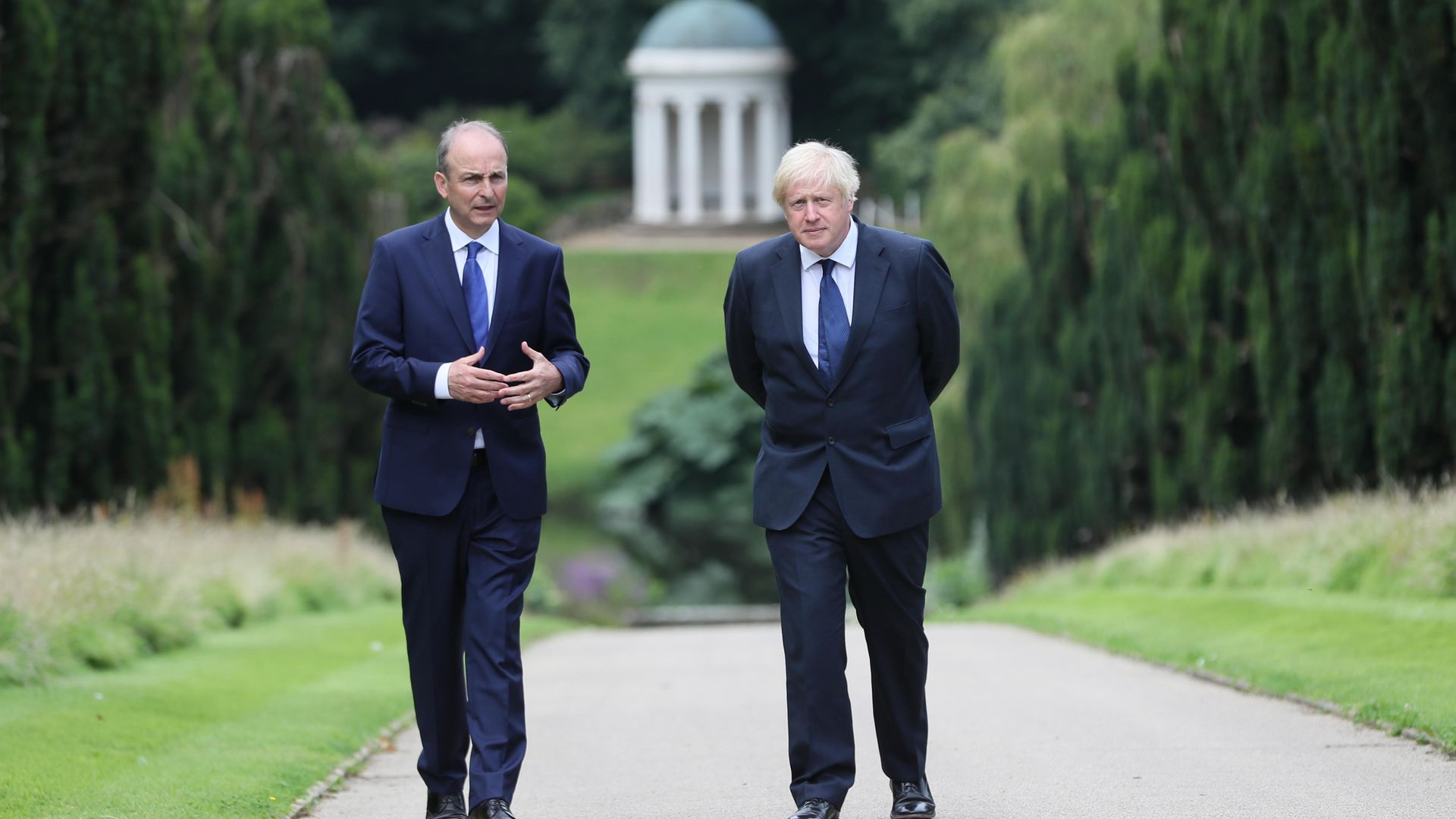 Prime minister Boris Johnson (right) and Irish taoiseach Micheal Martin walking in the gardens of Hillsborough Castle during a visit the prime minister's made to Belfast. - Credit: PA