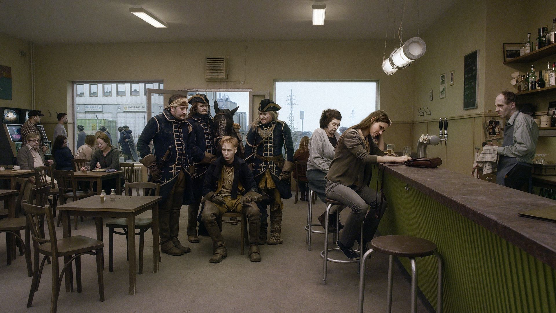 King Charles XII's army find themselves in a present-day cafe in A Pigeon Sat on a Branch Reflecting on Existence - Credit: Studio 24