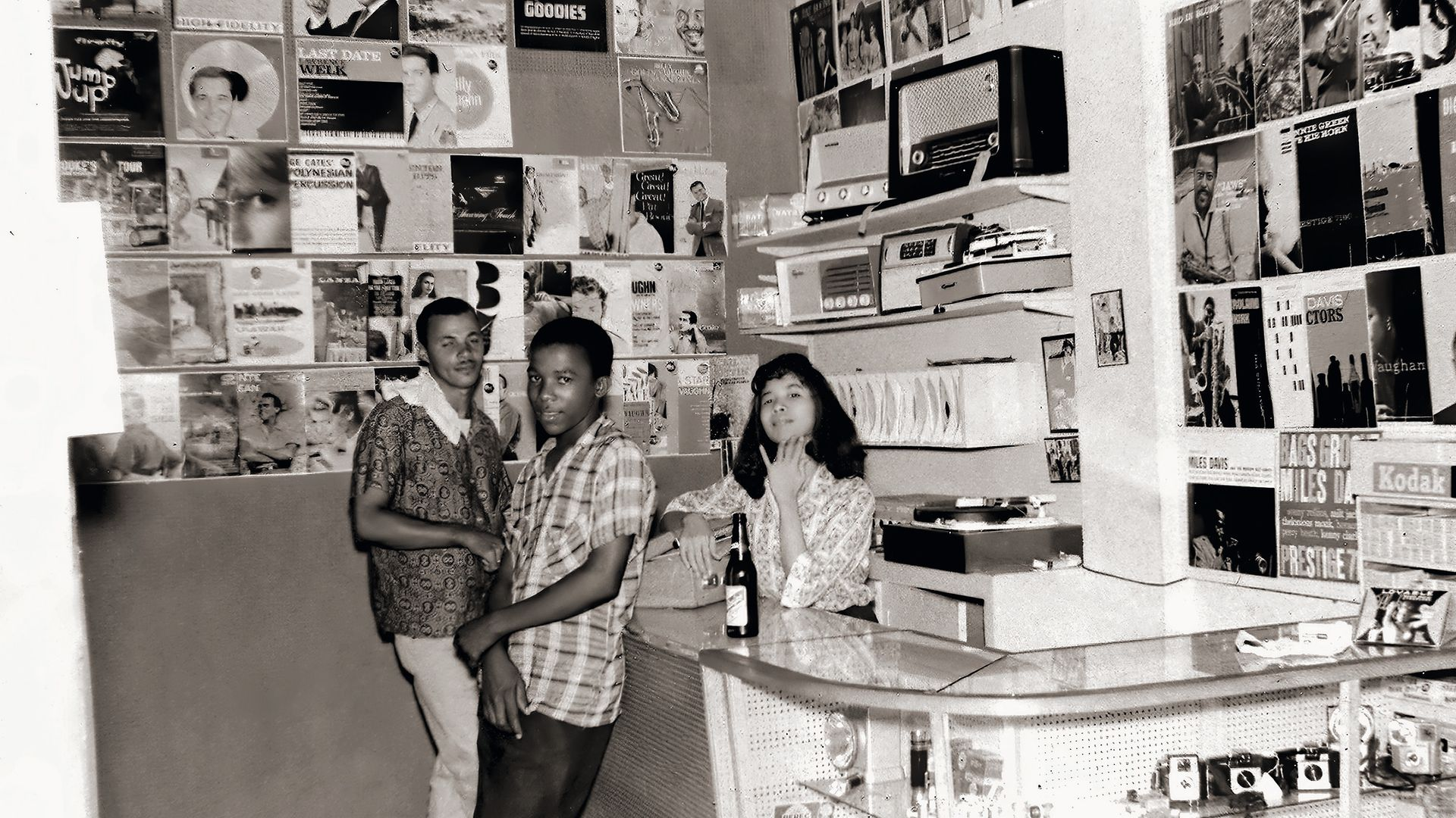 Patricia Chin behind the counter of Randy's Record Mart, in 1957 - Credit: VP
