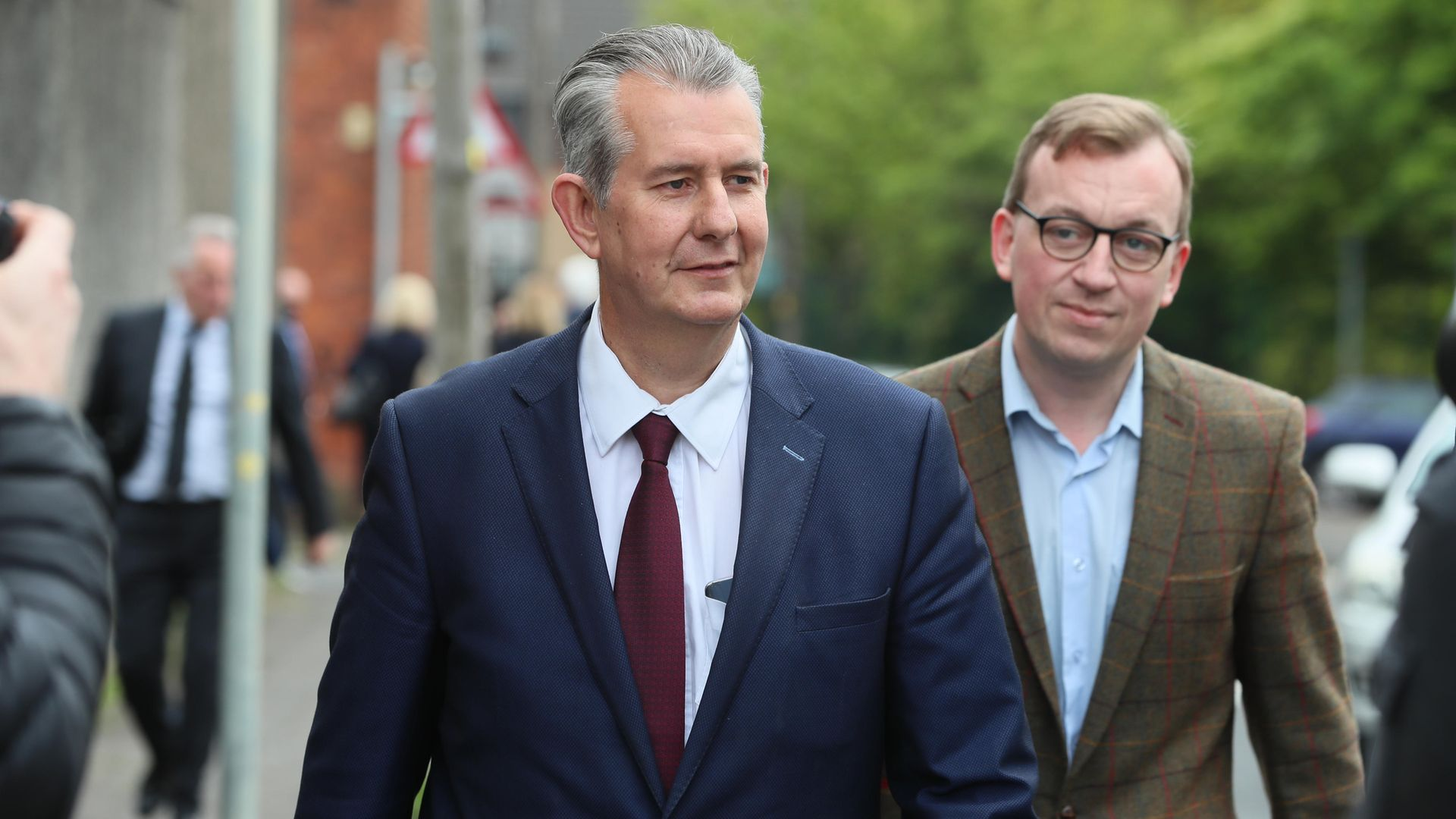 Edwin Poots (right) the Northern Ireland Minister of Agriculture, Environment, and Rural Affairs (DAERA) is followed by DUP MLA Christopher Stalford after leaving the Democratic Unionist Party (DUP) headquarters in Belfast following voting in the party's leadership election - Credit: PA