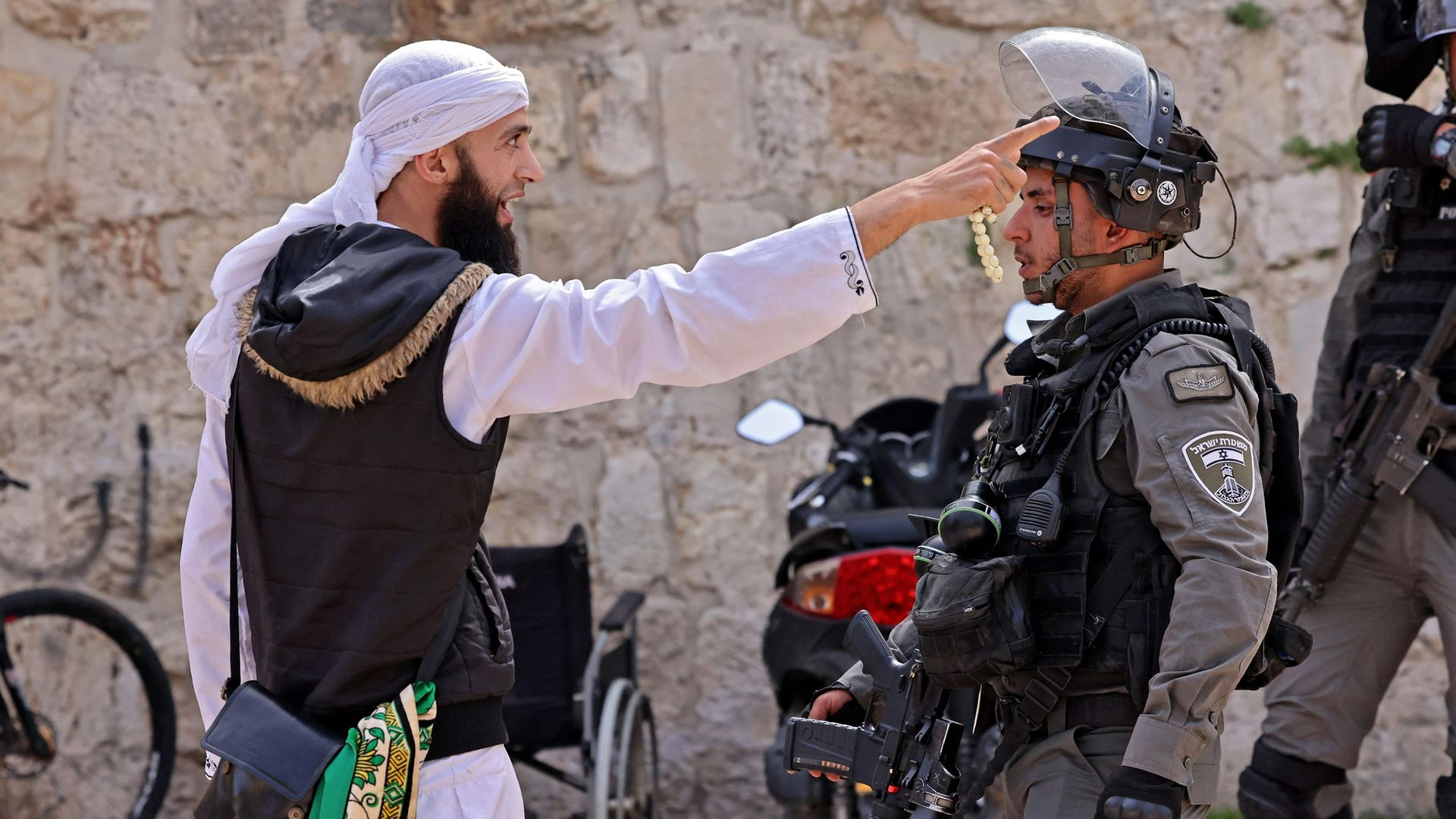 A Palestinian argues with an Israeli soldier in Jerusalem's Old City - Credit: AFP via Getty Images