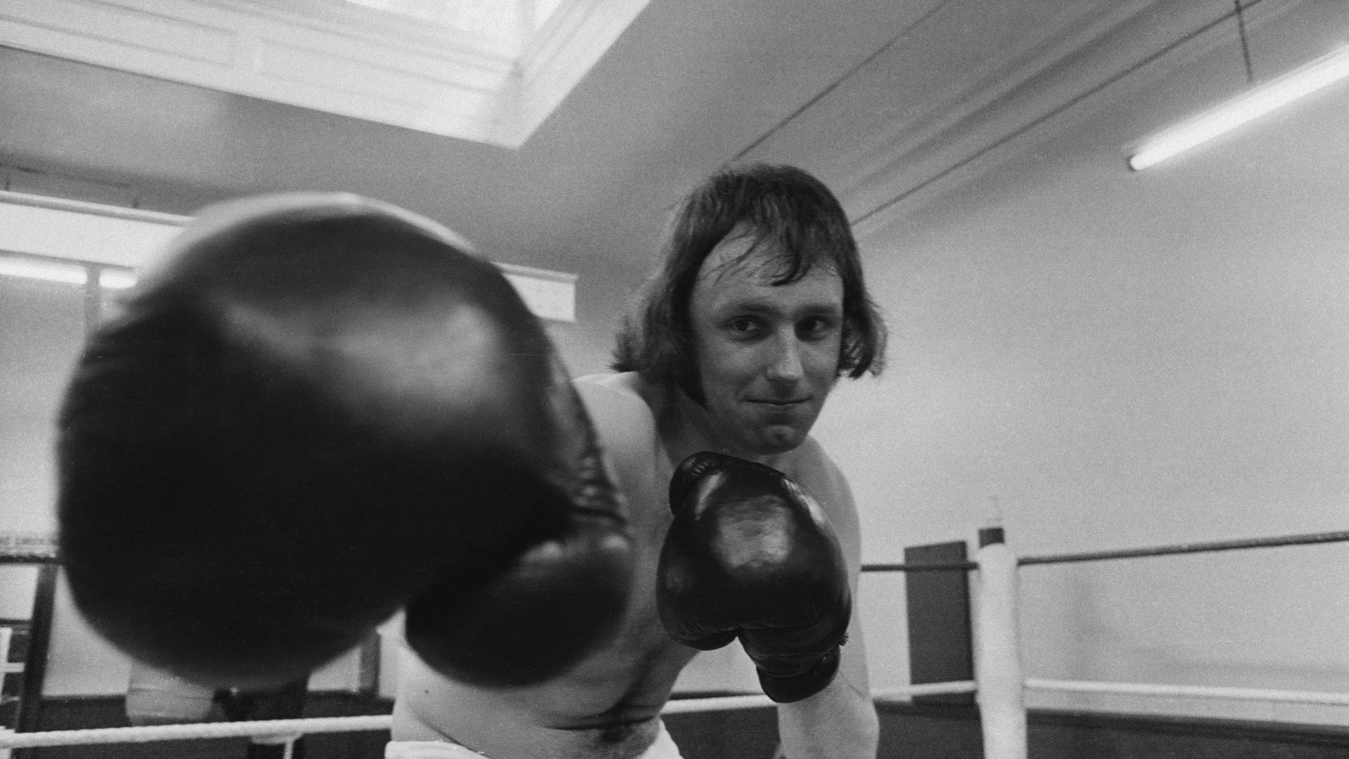 Paul Dacre, then reporter for the Daily Express, training in the boxing ring at a gym in 1972 - Credit: Getty Images