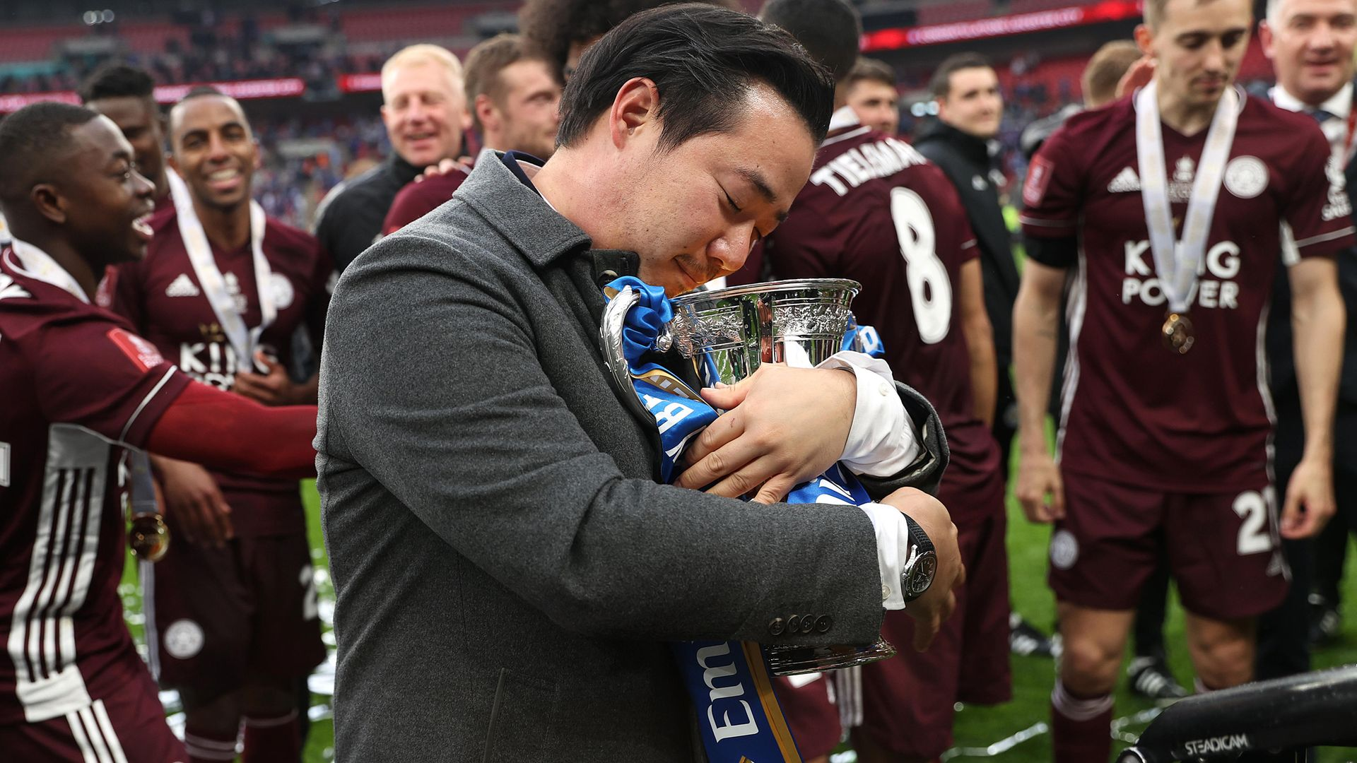 Aiyawatt Srivaddhanaprabha, aka Khun Top, chairman of Leicester City celebrates with the Emirates FA Cup trophy on May 15, 2021 - Credit: Photo by Eddie Keogh - The FA/The FA via Getty Images