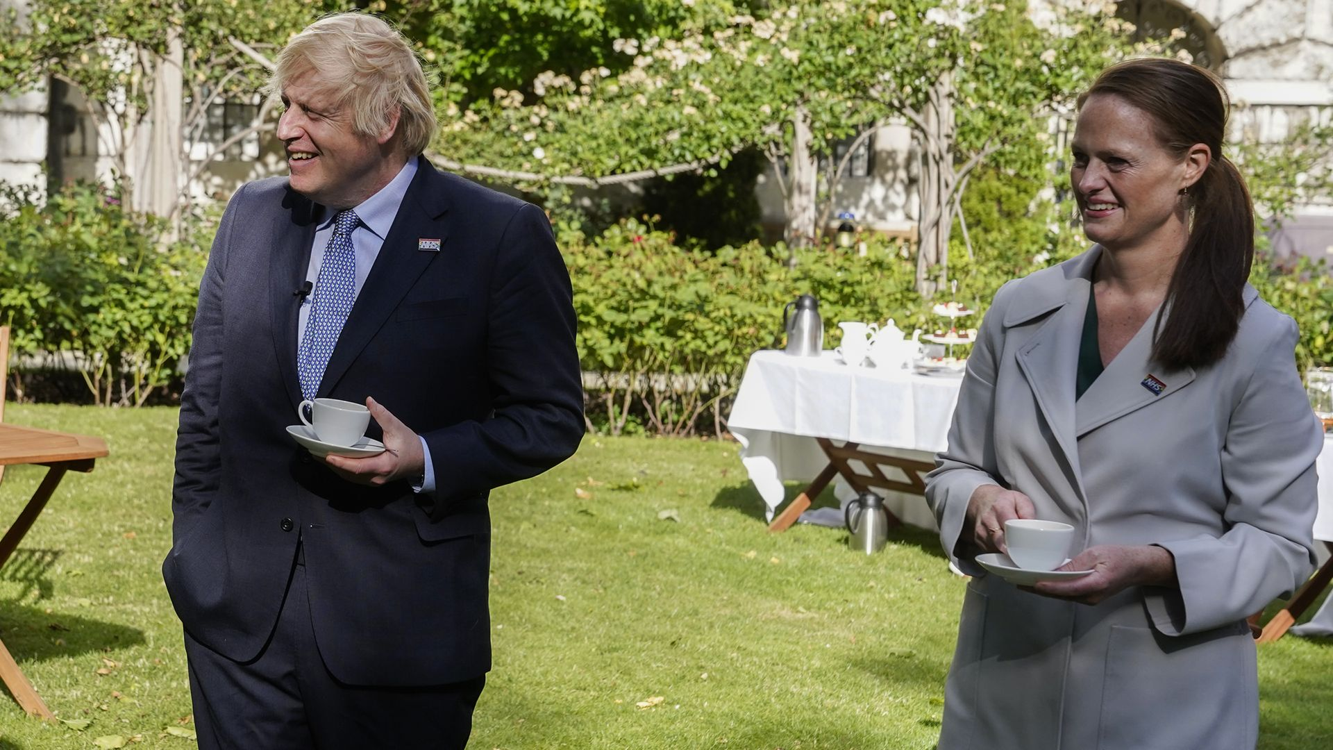 Jenny McGee (right) at a Downing Street garden party with Prime Minister Boris Johnson (left) who she looked after while he was in hospital suffering from Covid-19 - Credit: PA