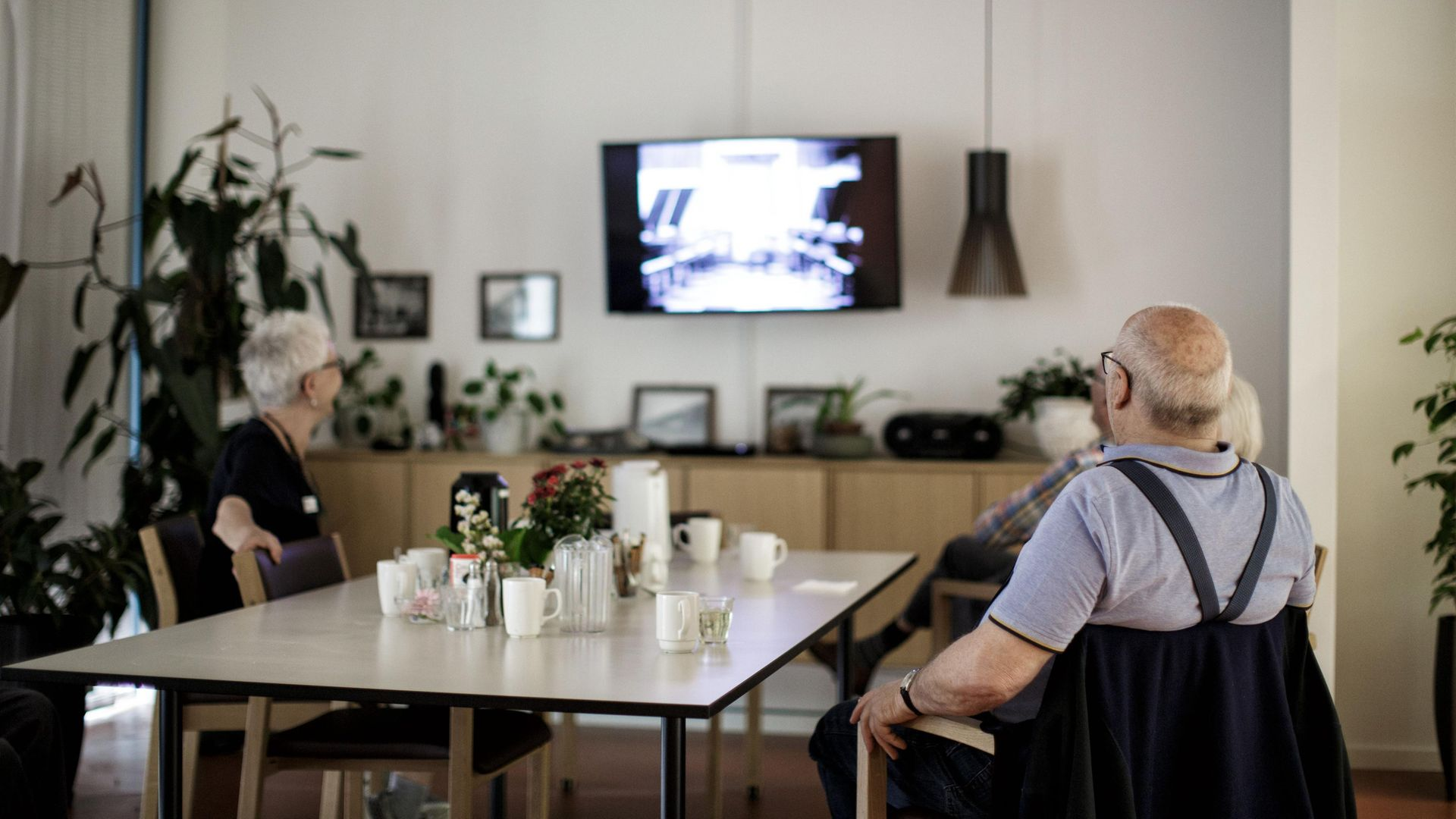 Care home residents watch a movie in Hillerod, near Copenhagen. Denmark has the highest % of GDP spend on social care in Europe. - Credit: AFP via Getty Images