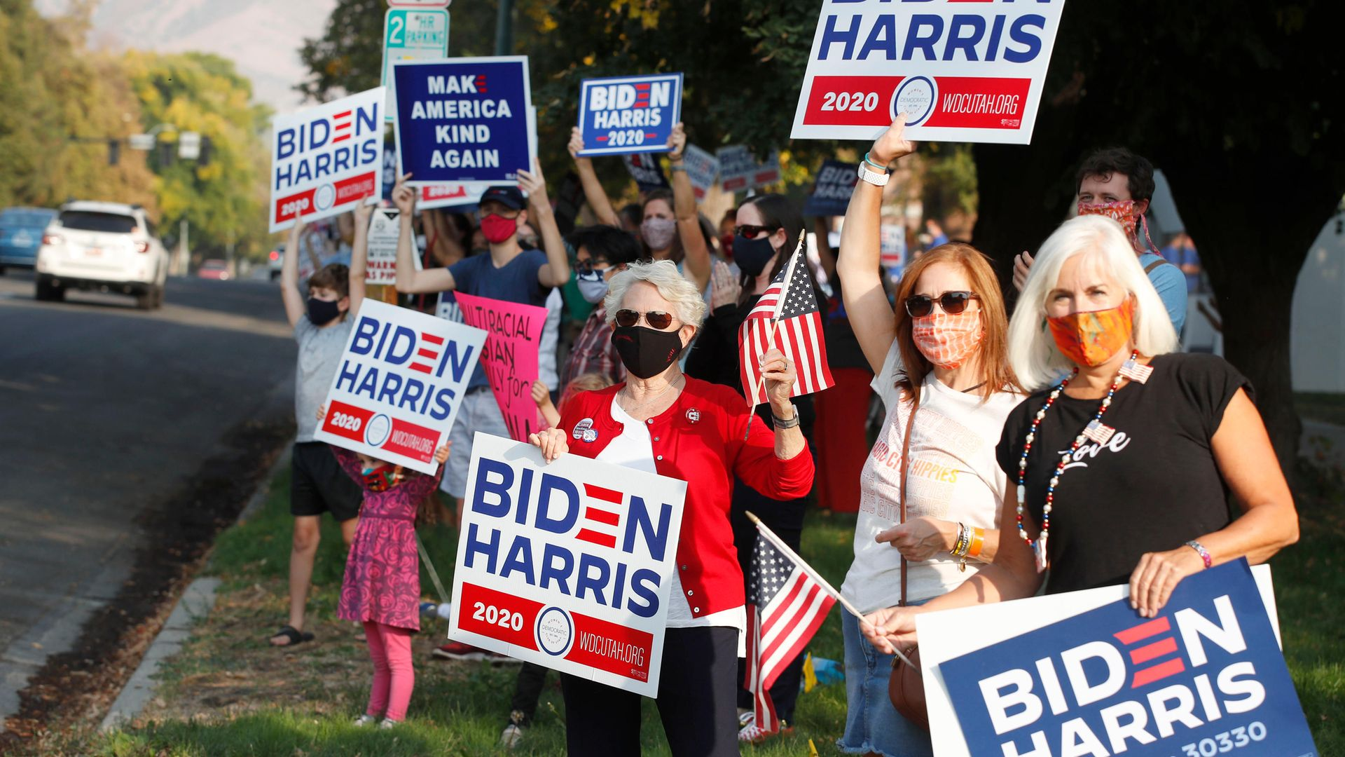 Women in Utah show their support for Joe Biden during the US election campaign; America's women are strongly Democratic and have been vital to the party's electoral success - Credit: AFP via Getty Images