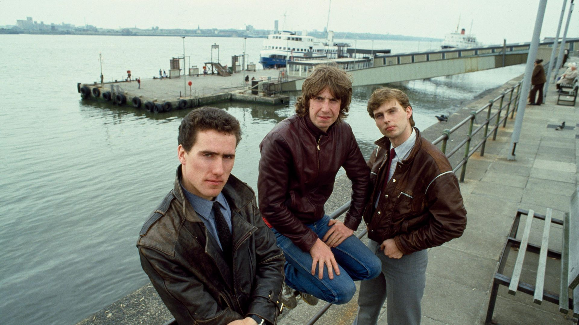 From left, Andy McCluskey, Malcolm Holmes and Paul Humphreys of Orchestral Manoeuvres in the Dark on Liverpool's waterfront in 1982 - Credit: Getty Images