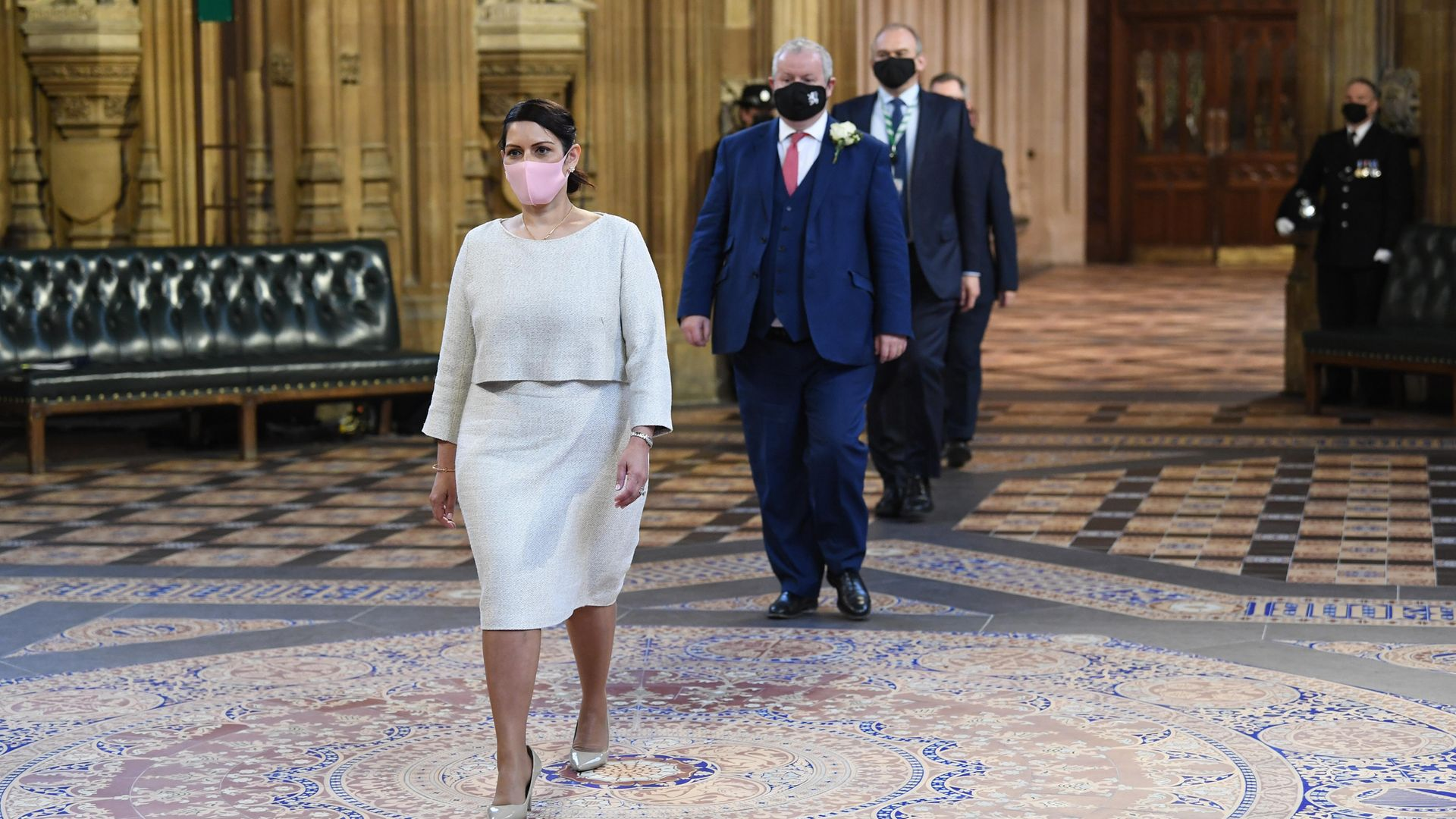 Priti Patel walks through the Central Lobby on the way to listen to the Queen's Speech - Credit: PA