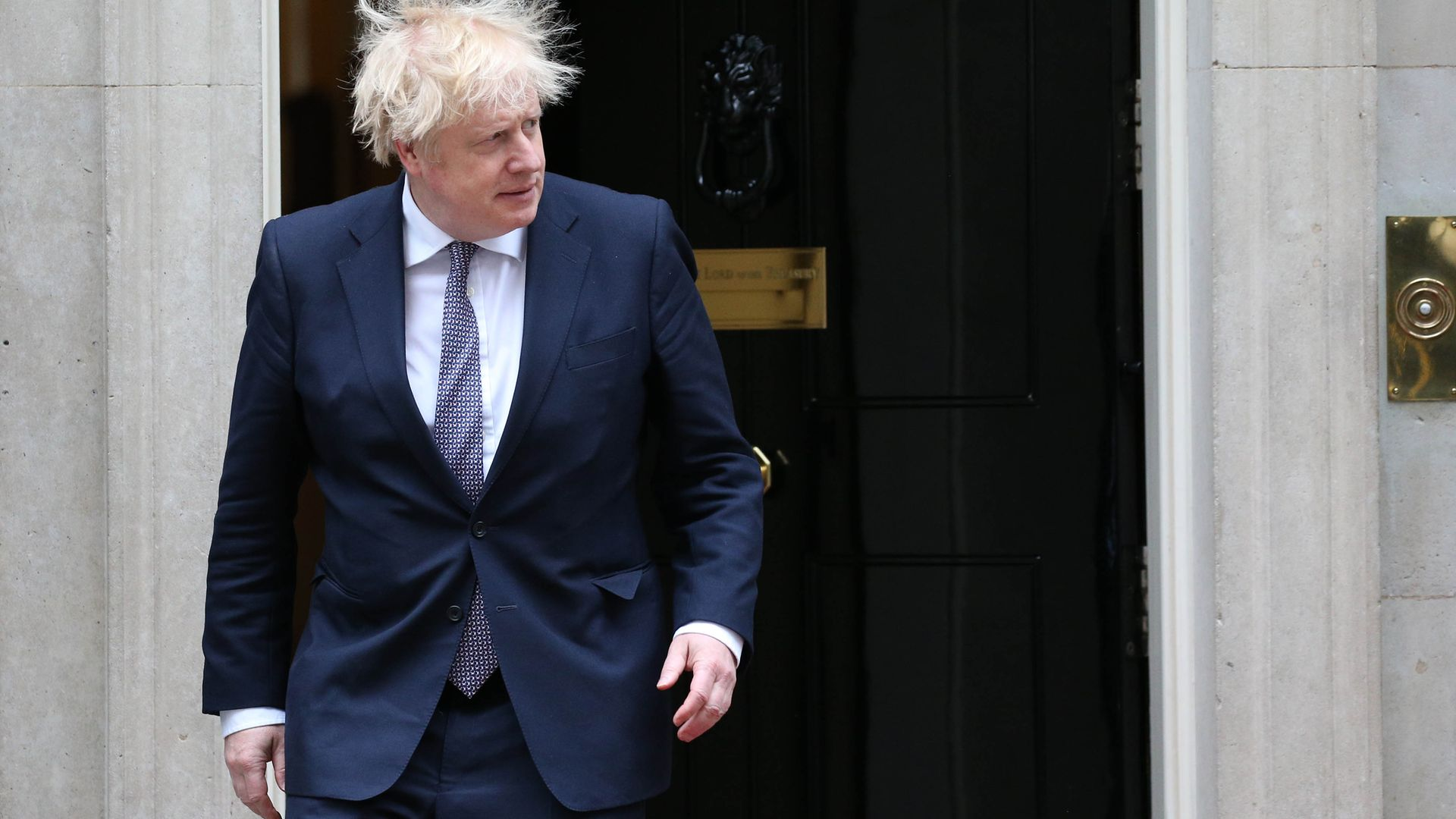 Prime Minister Boris Johnson outside 10 Downing Street in London - Credit: PA
