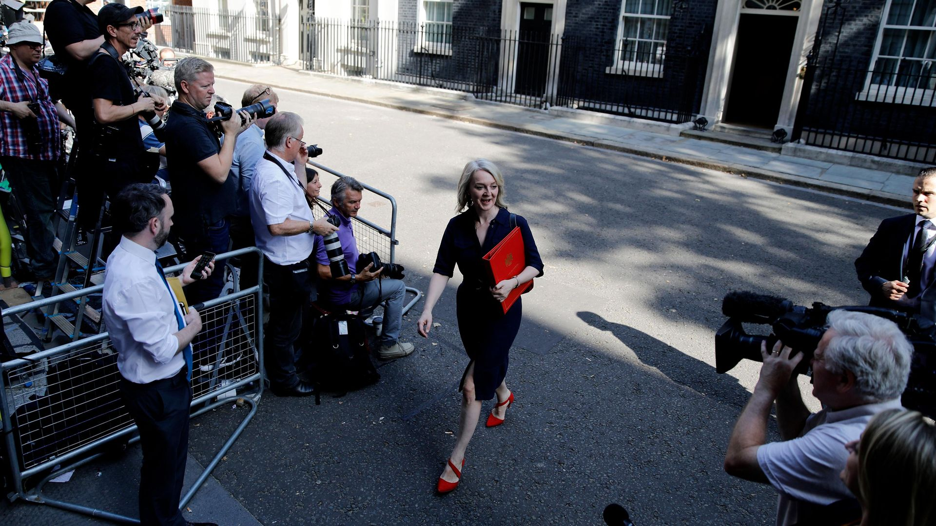 Liz Truss leaves 10 Downing street after a cabinet meeting in July 2019, the day after her appointment as trade secretary - Credit: AFP via Getty Images