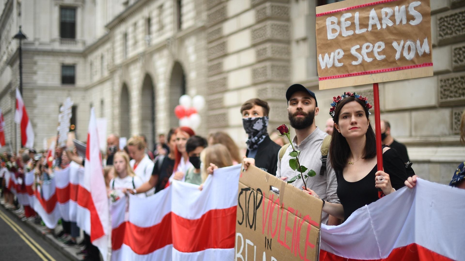 A demonstration outside the Foreign & Commonwealth Office in central London calling for authoritarian President Alexander Lukashenko to resign - Credit: PA
