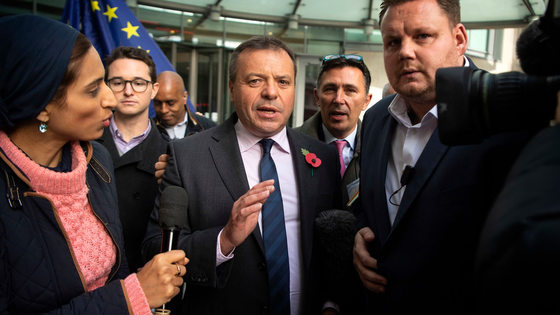 Leave campaigner Arron Banks (centre) claims he's being discriminated against for his political views - Credit: PA