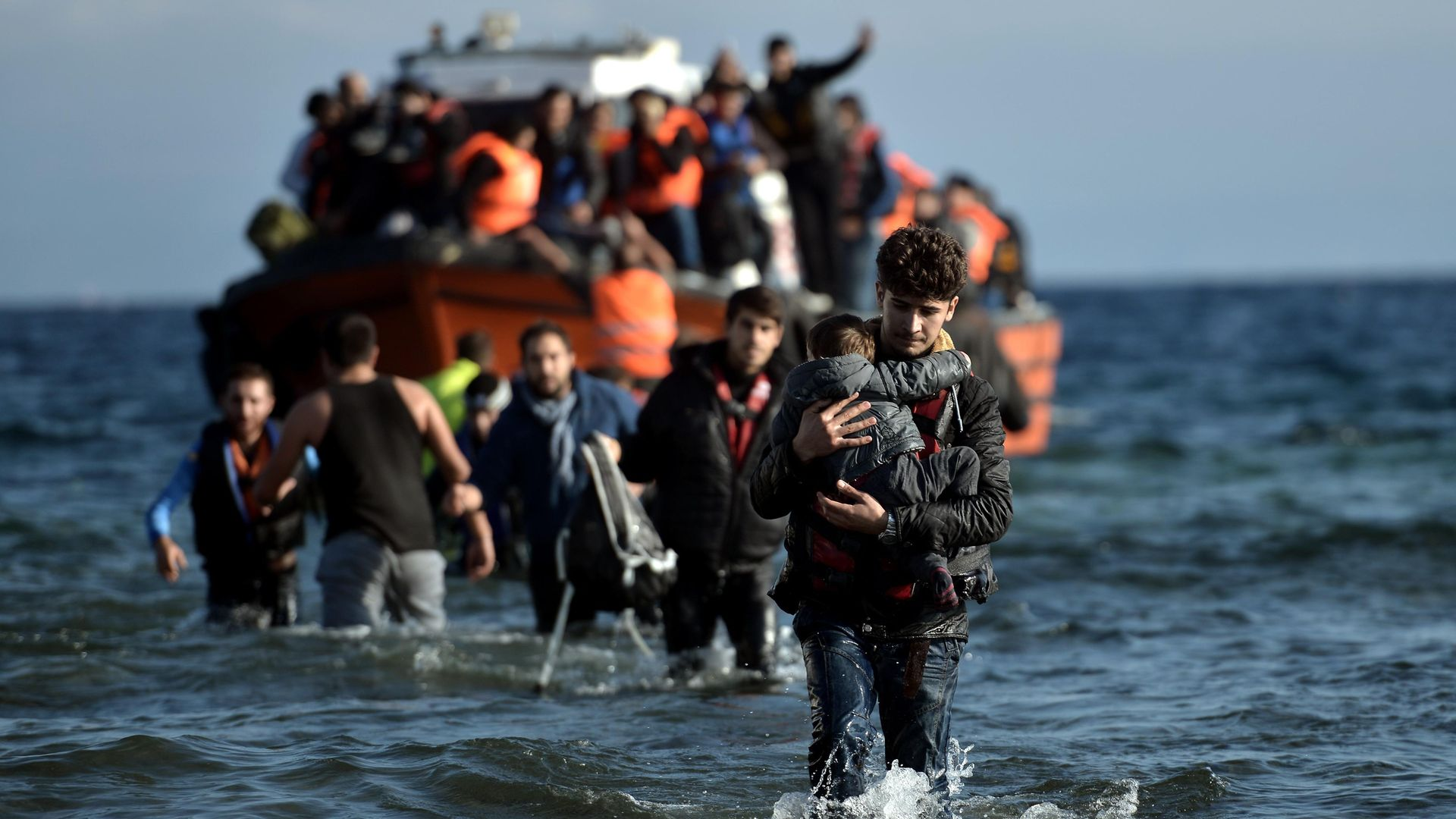 Migrants arrive on the Greek island of Lesbos after crossing the Aegean Sea from Turkey in 2015 - Credit: AFP via Getty Images