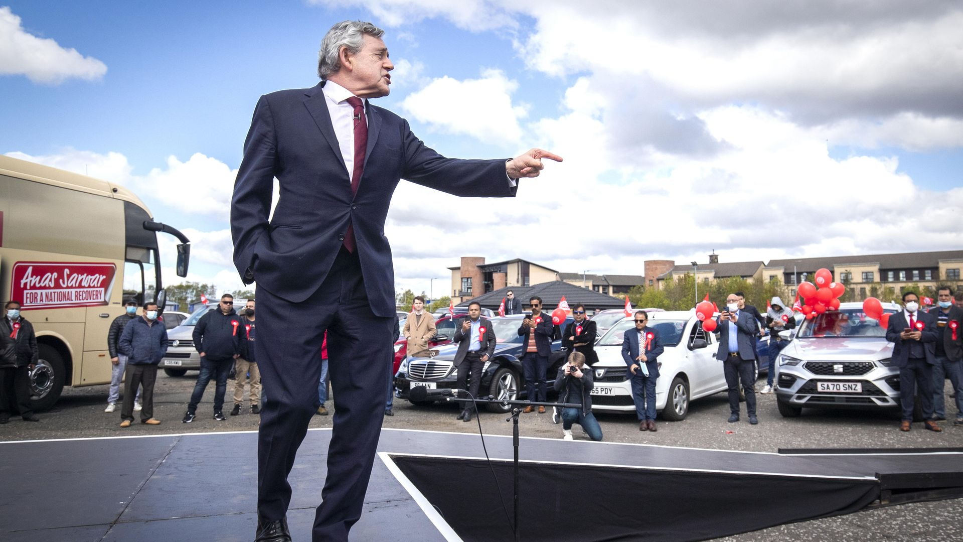 Former prime minister Gordon Brown speaks at a Scottish Labour drive-in rally in Glasgow during campaigning for the Scottish Parliamentary election - Credit: PA