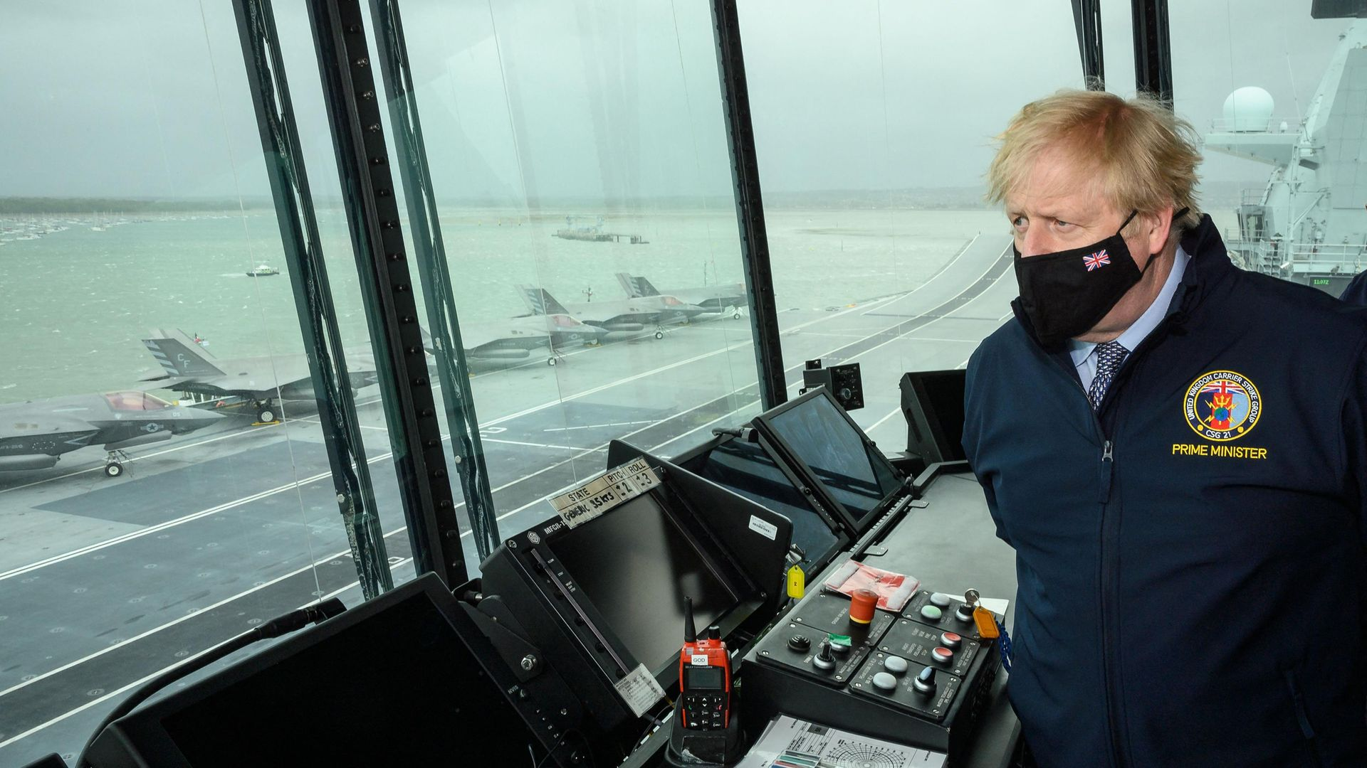 Boris Johnson  during a visit to HMS Queen Elizabeth aircraft carrier in Portsmouth,  May 21, 2021 - Credit: Photo by LEON NEAL/POOL/AFP via Getty Images