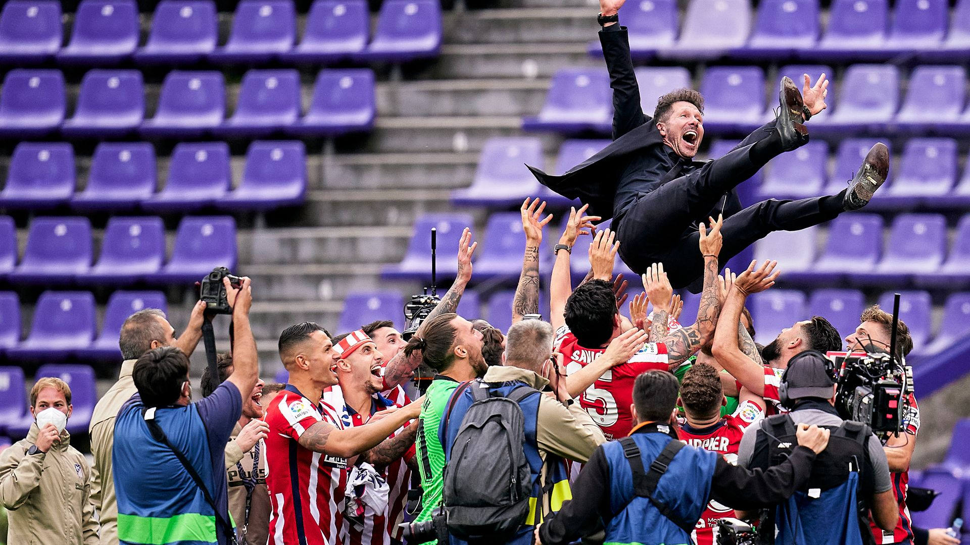 Atletico Madrid coach Diego Simeone is thrown by the air after winning the La Liga title - Credit: Photo by Pedro Salado/Quality Sport Images/Getty Images