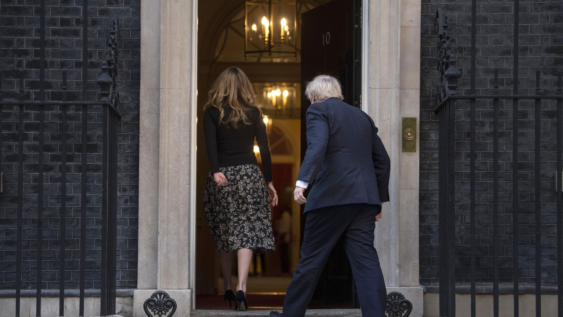 Prime Minister Boris Johnson and Carrie Symonds walking back into No.10 Downing Street - Credit: PA