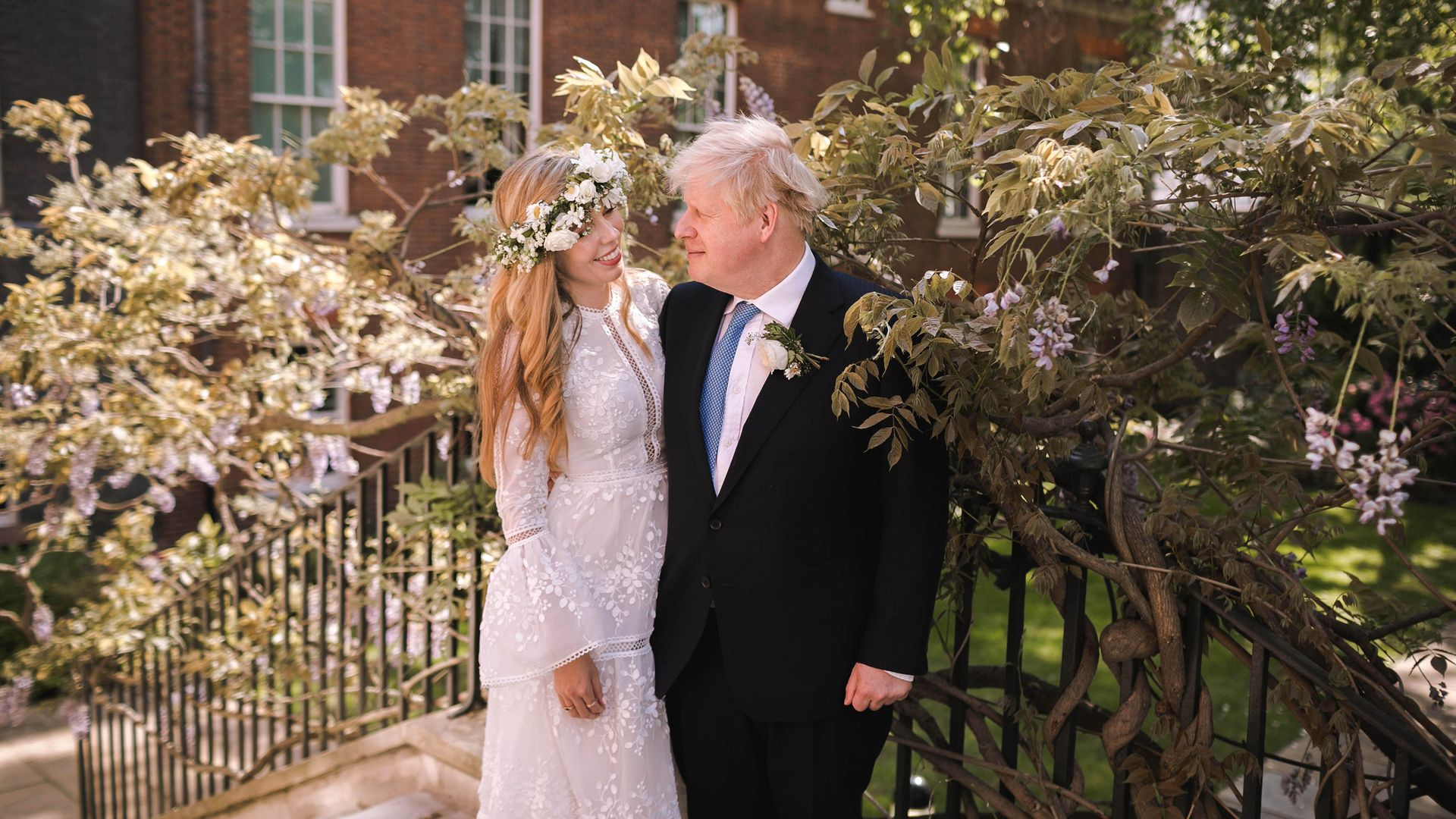 Boris Johnson poses with his wife Carrie in the garden of 10 Downing Street following their wedding at Westminster Cathedral, May 29, 2021 - Credit: Photo by Rebecca Fulton / Downing Street via Getty Images