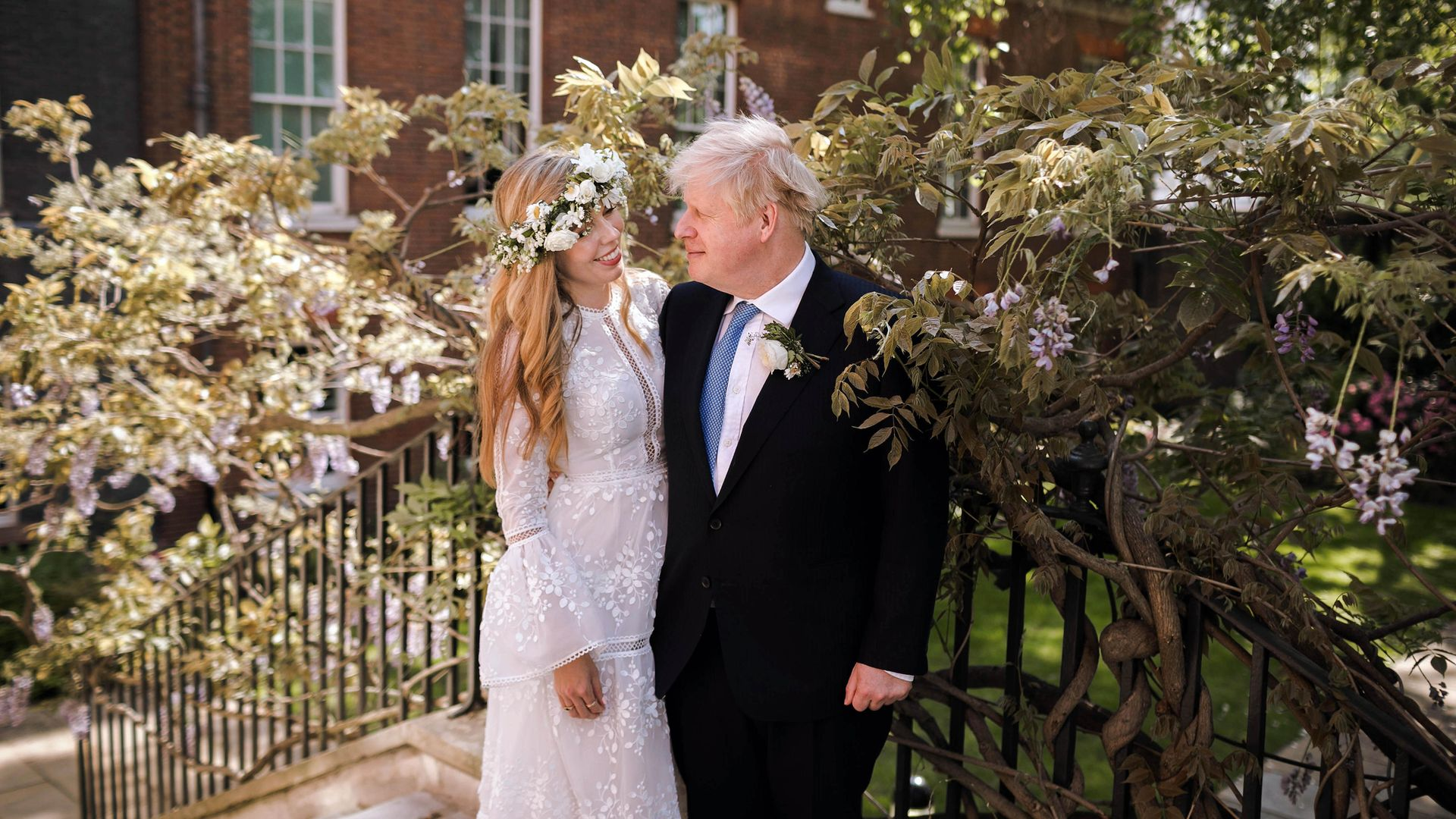 Prime Minister Boris Johnson and Carrie Johnson in the garden of 10 Downing Street after their wedding - Credit: PA