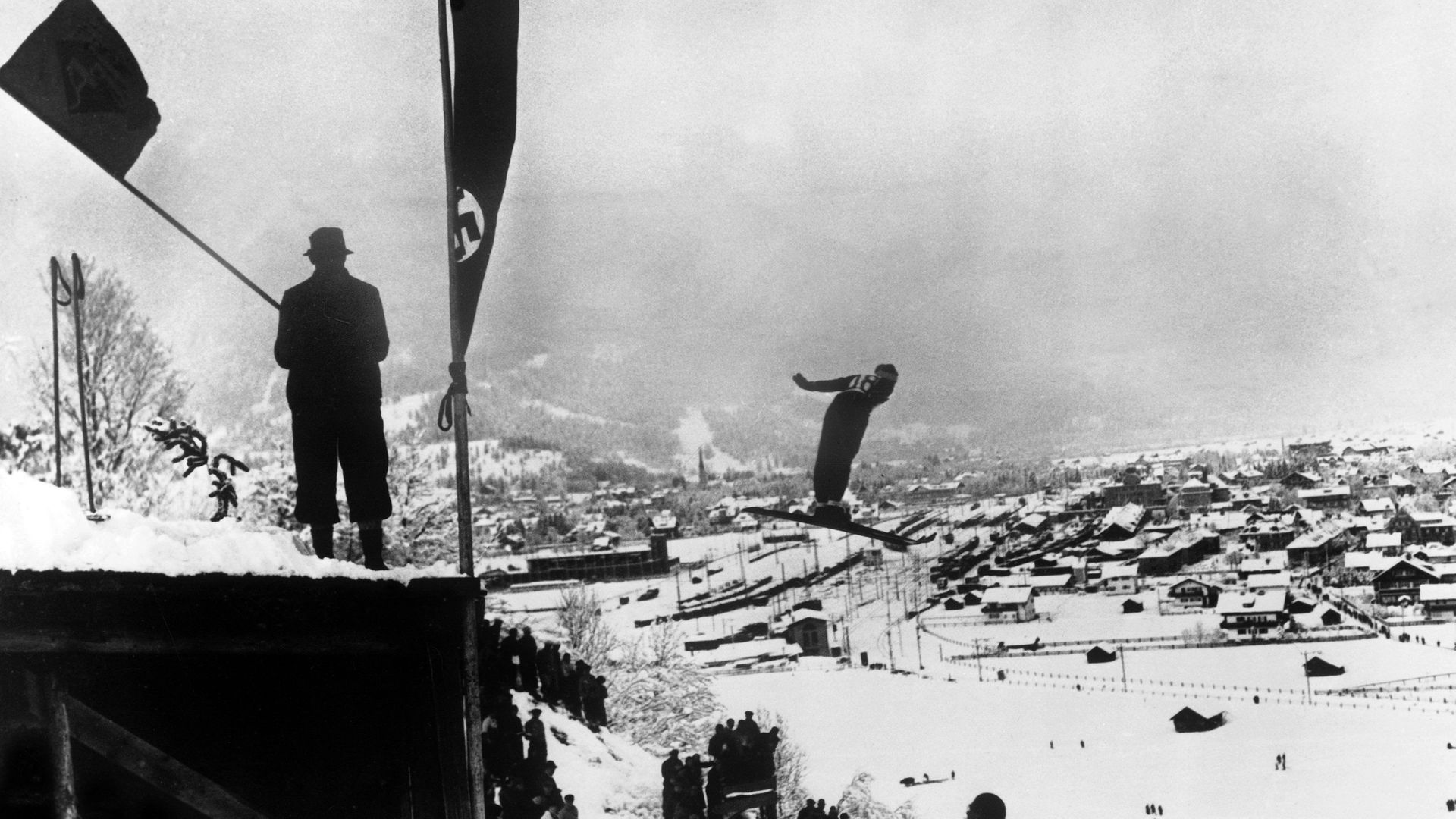Birger Ruud jumps at Garmisch-Partenkirchen, where a swastika flag flies. He later won the Olympics there - Credit: Gamma-Keystone via Getty Images