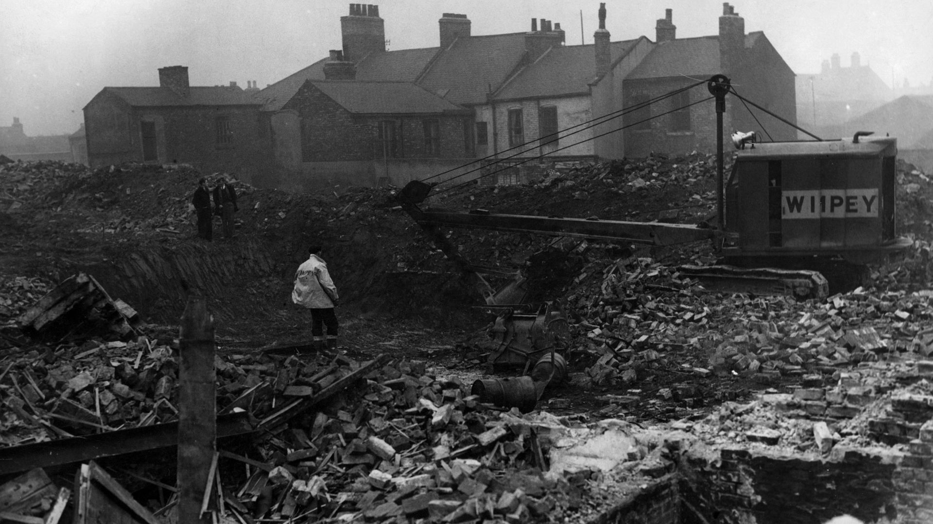 Slum clearance at St Hilda's, Middlesbrough, in 1955 - Credit: Getty Images