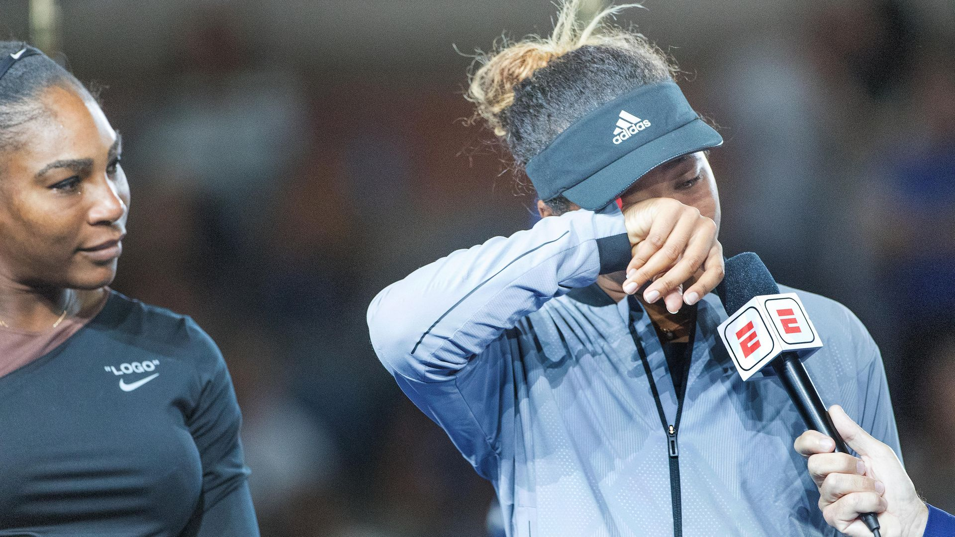 Naomi Osaka of Japan wipes away the tears after beating Serena Williams to win the 2018 US Open - Credit: Photo by Tim Clayton/Corbis via Getty Images