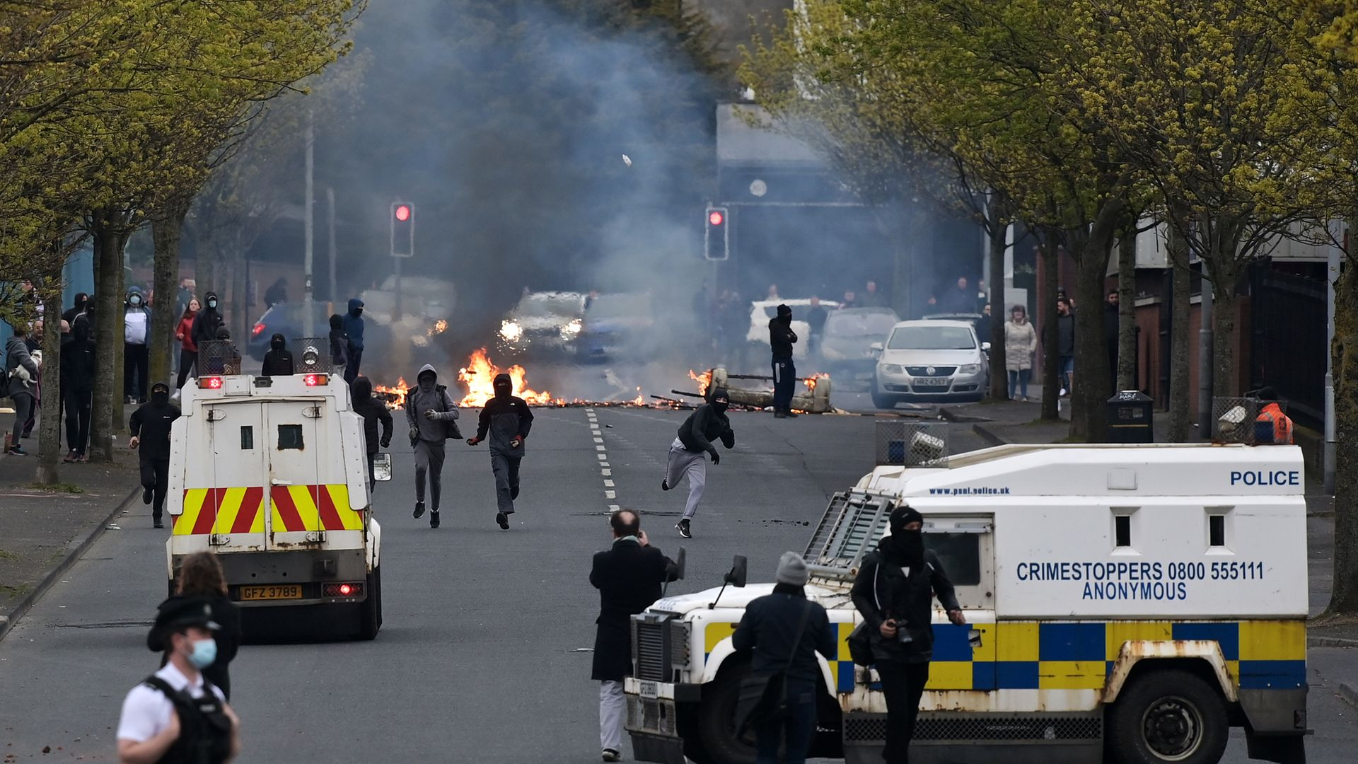 Loyalists light fires and throw projectiles at police in Belfast, amid tensions over the Protocol, in April 2021 - Credit: Getty Images