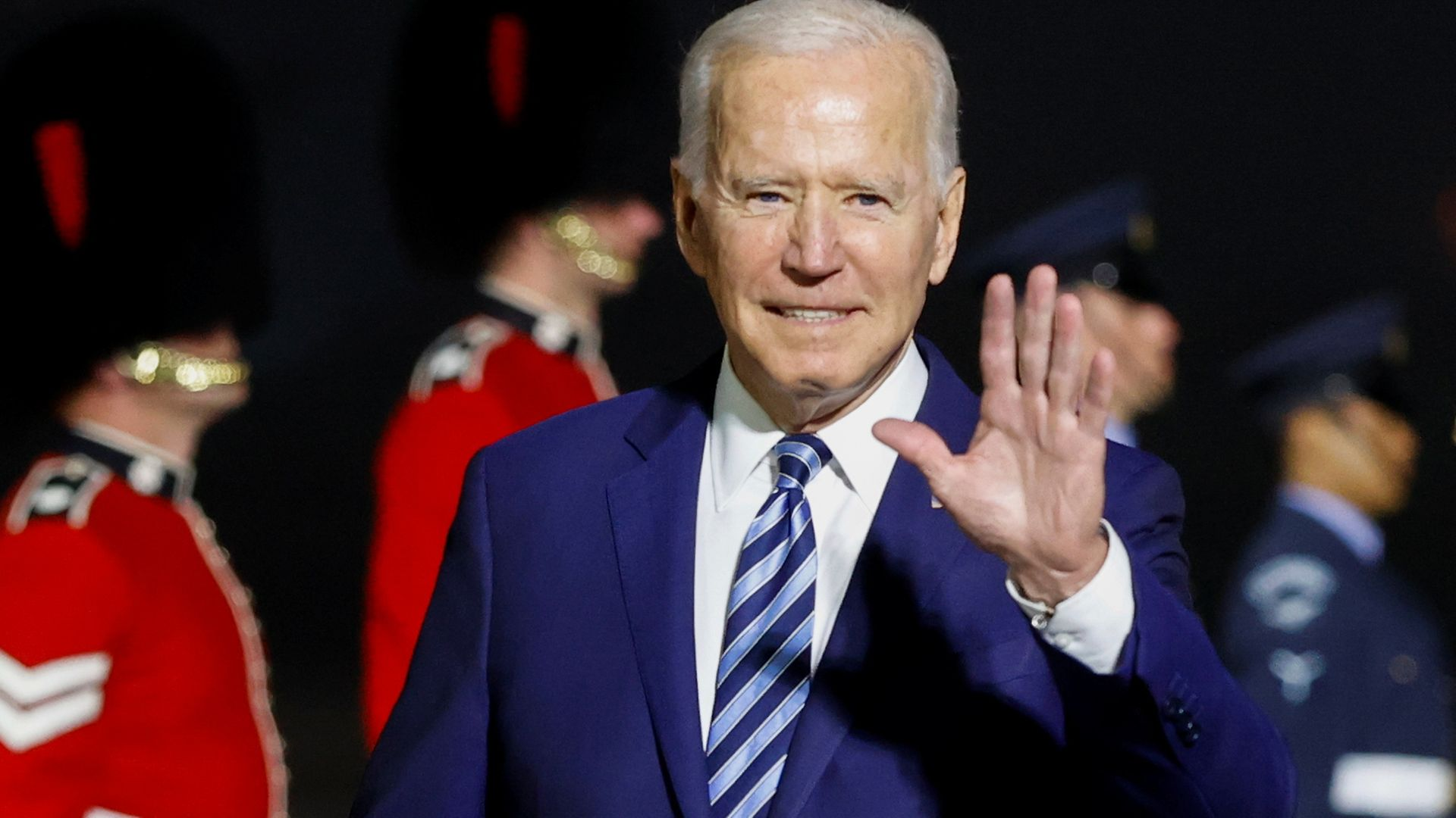 US President Joe Biden waves on arrival on Air Force One at Cornwall Airport Newquay ahead of the G7 summit - Credit: PA