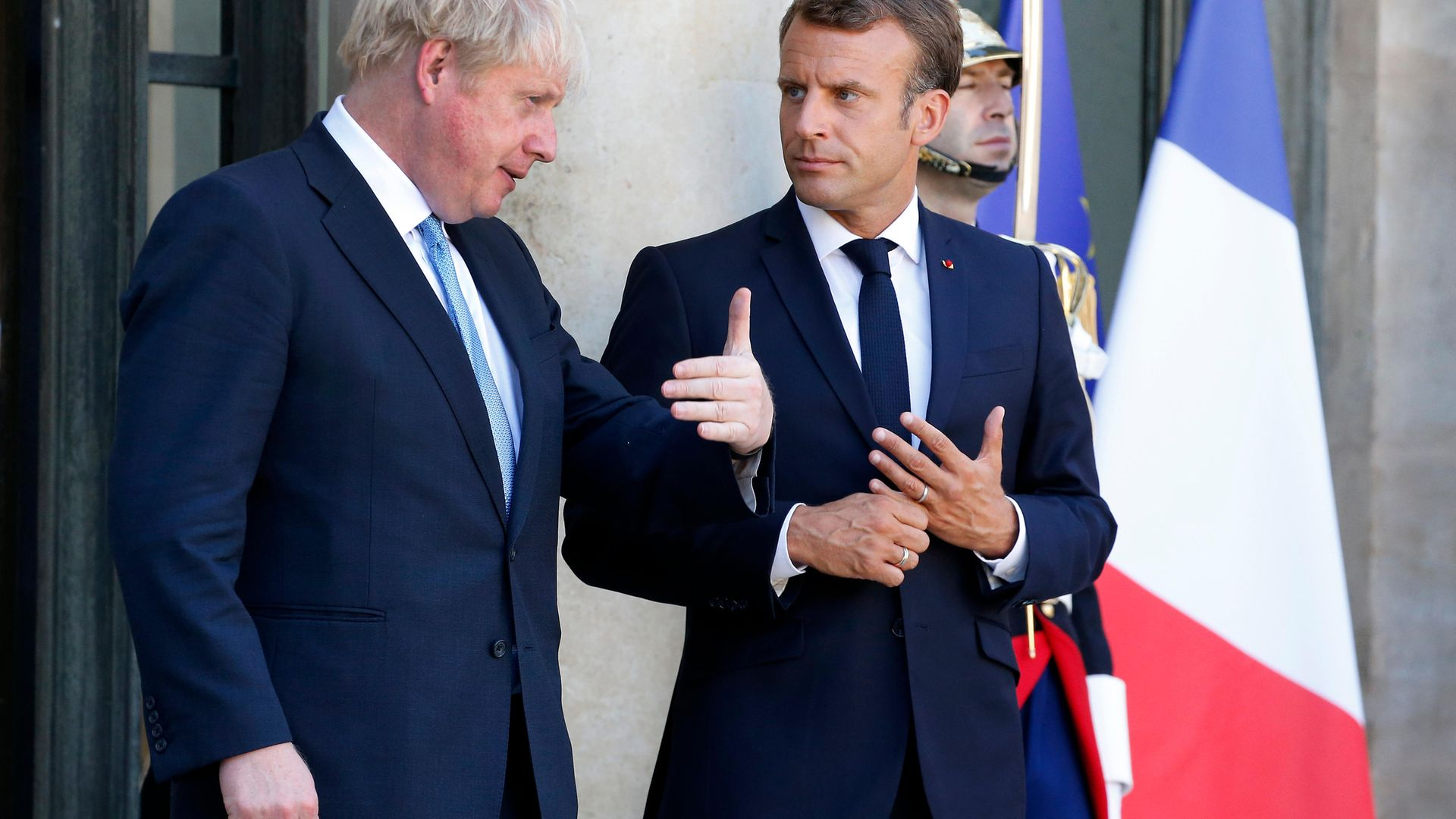 French president Emmanuel Macron accompanies British prime minister Boris Johnson at the Elysee Presidential Palace on August 22, 2019 in Paris - Credit: Photo by Chesnot/Getty Images