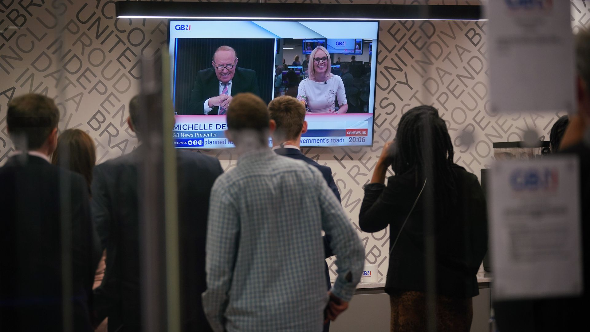 GB News staff watch Andrew Neil and Michelle Dewberry broadcast during the launch of TV channel GB News, Sunday June 13, 2021 - Credit: PA Wire/PA Images